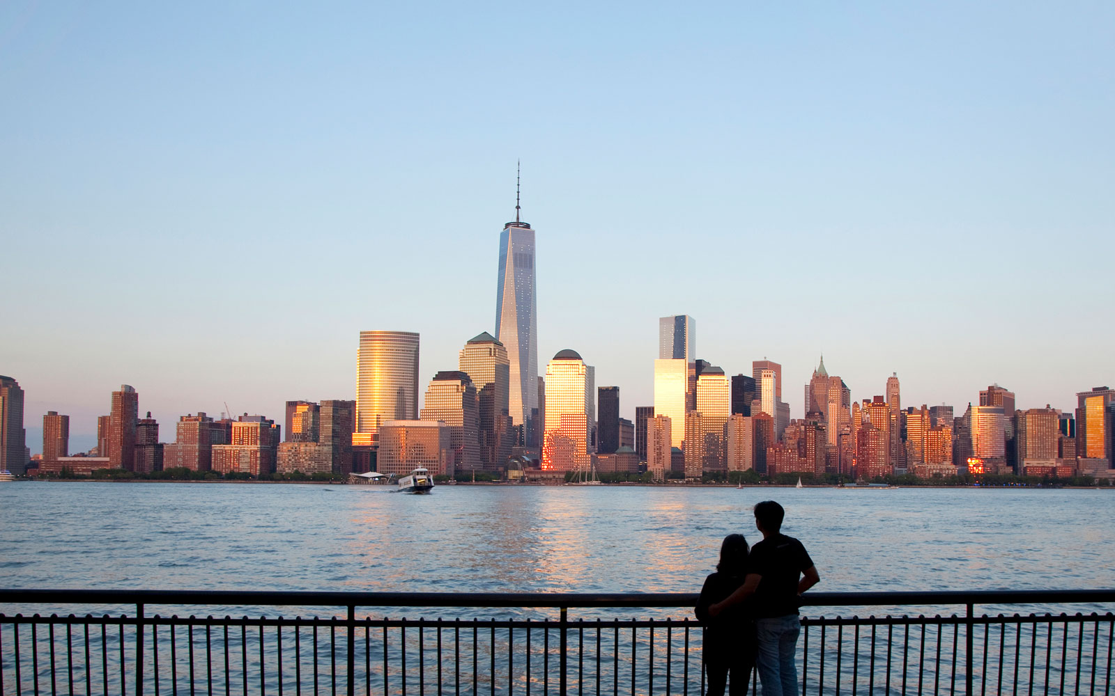 Couple viewing lower Manhattan and One World trade centre.