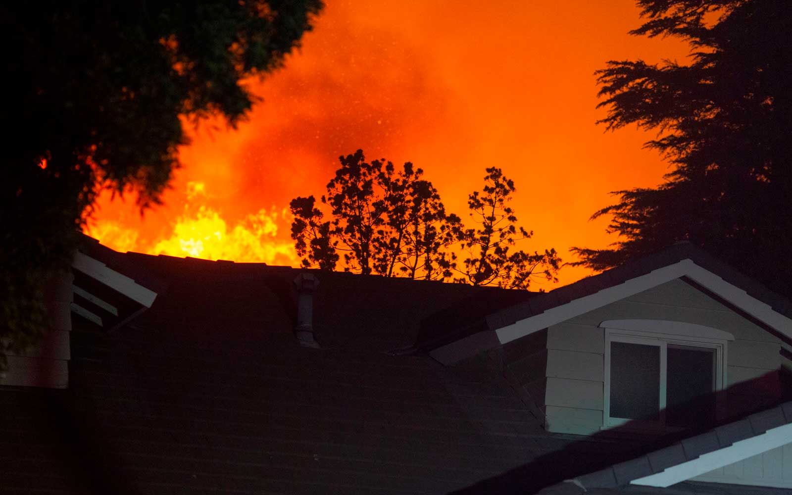 Massive fire in Los Angeles forces highway closures, thousands of evacuations