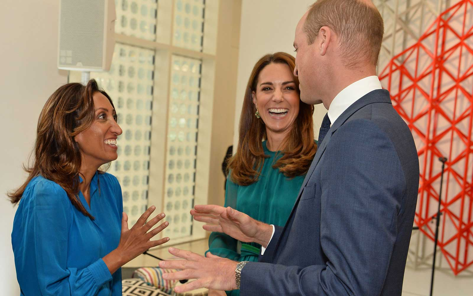 Britain's Prince William, Duke of Cambridge and Britain's Catherine, Duchess of Cambridge chat with English stand-up comedian Shazia Murza