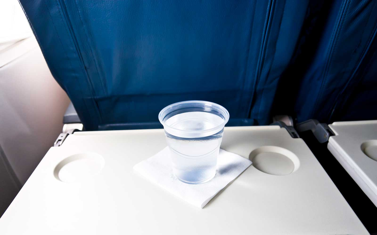 Airlines cup of water, beverage