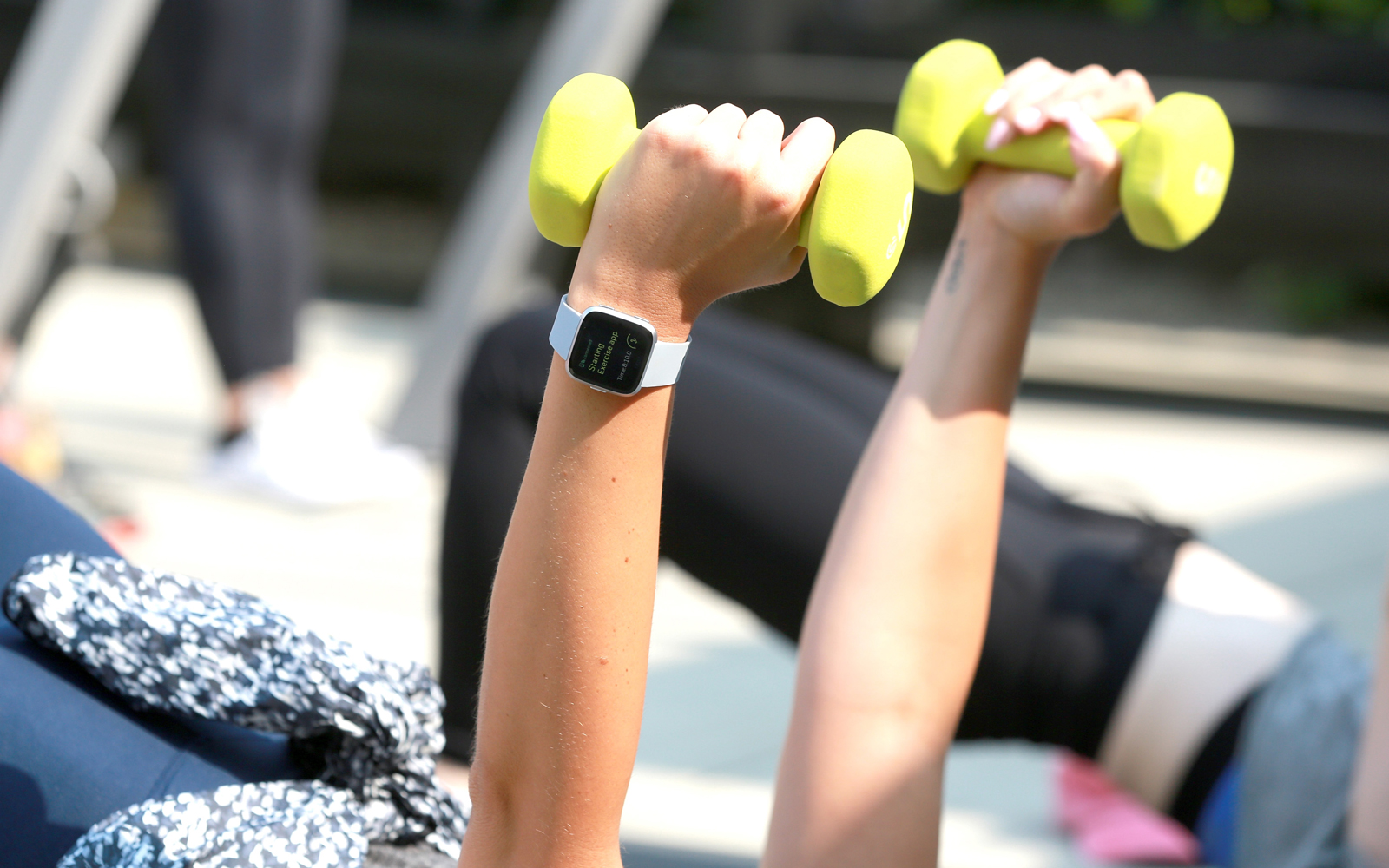 Person exercising with Fitbit