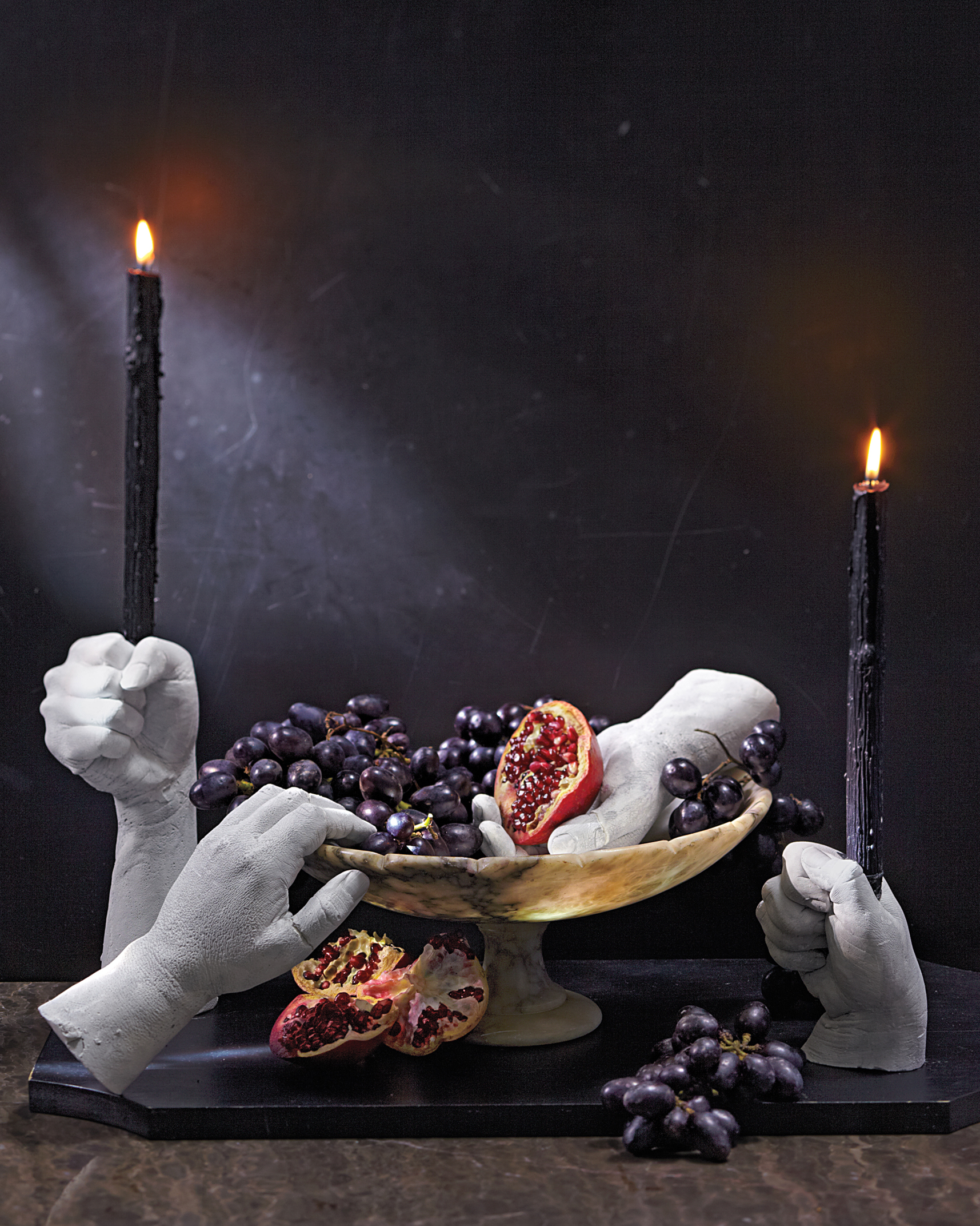On Halloween, consider taking your fear in hand and making five-fingered candleholders and tabletop decorations.