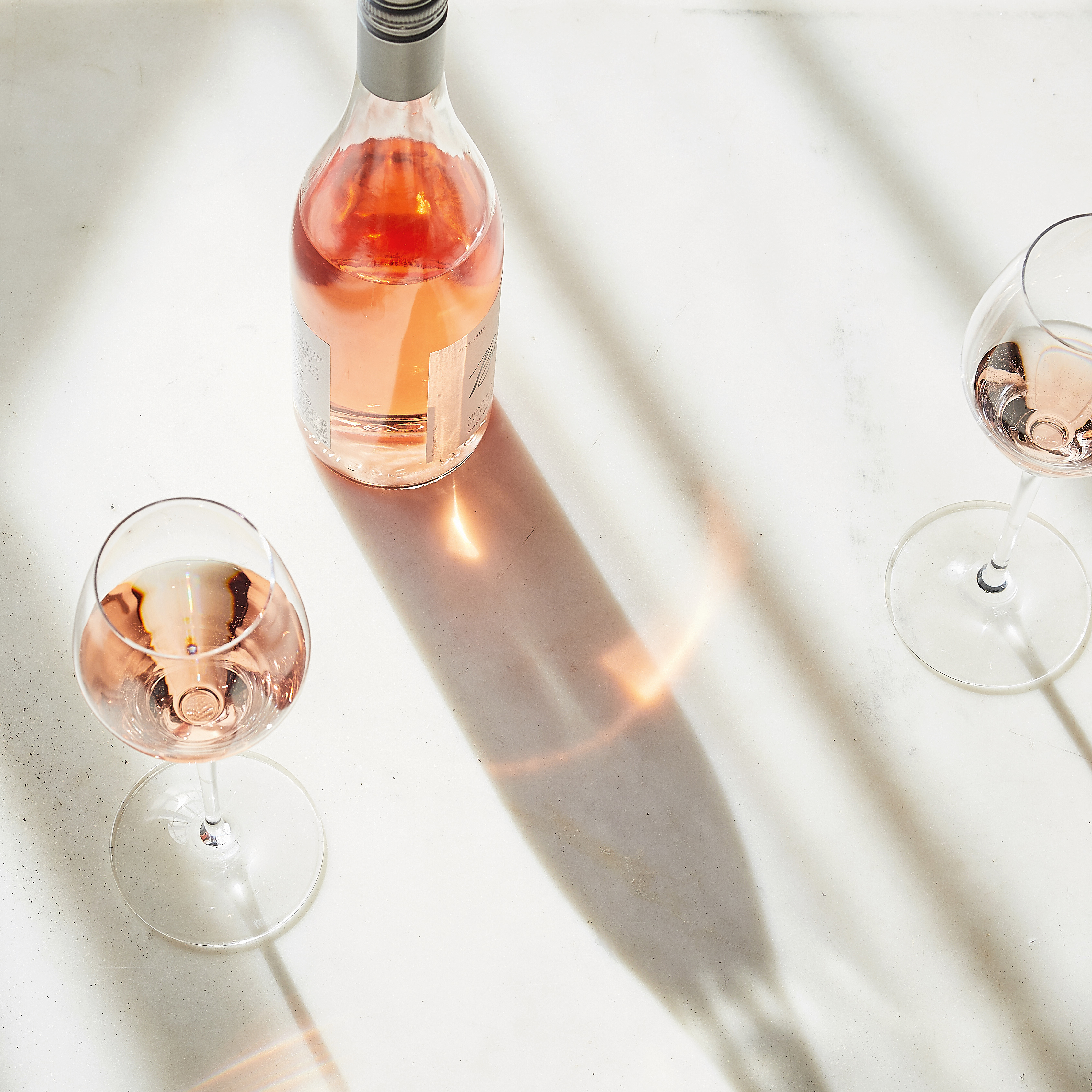 rose wine bottle and glass on table