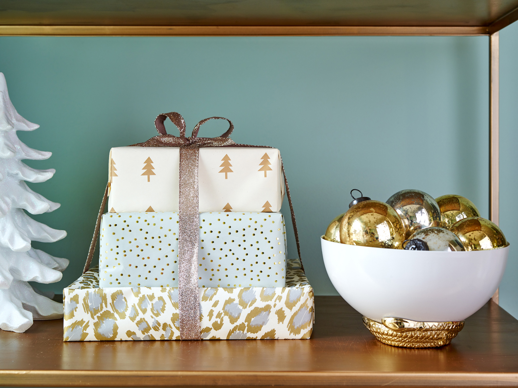 white gold and silver printed wrapping paper covered gifts