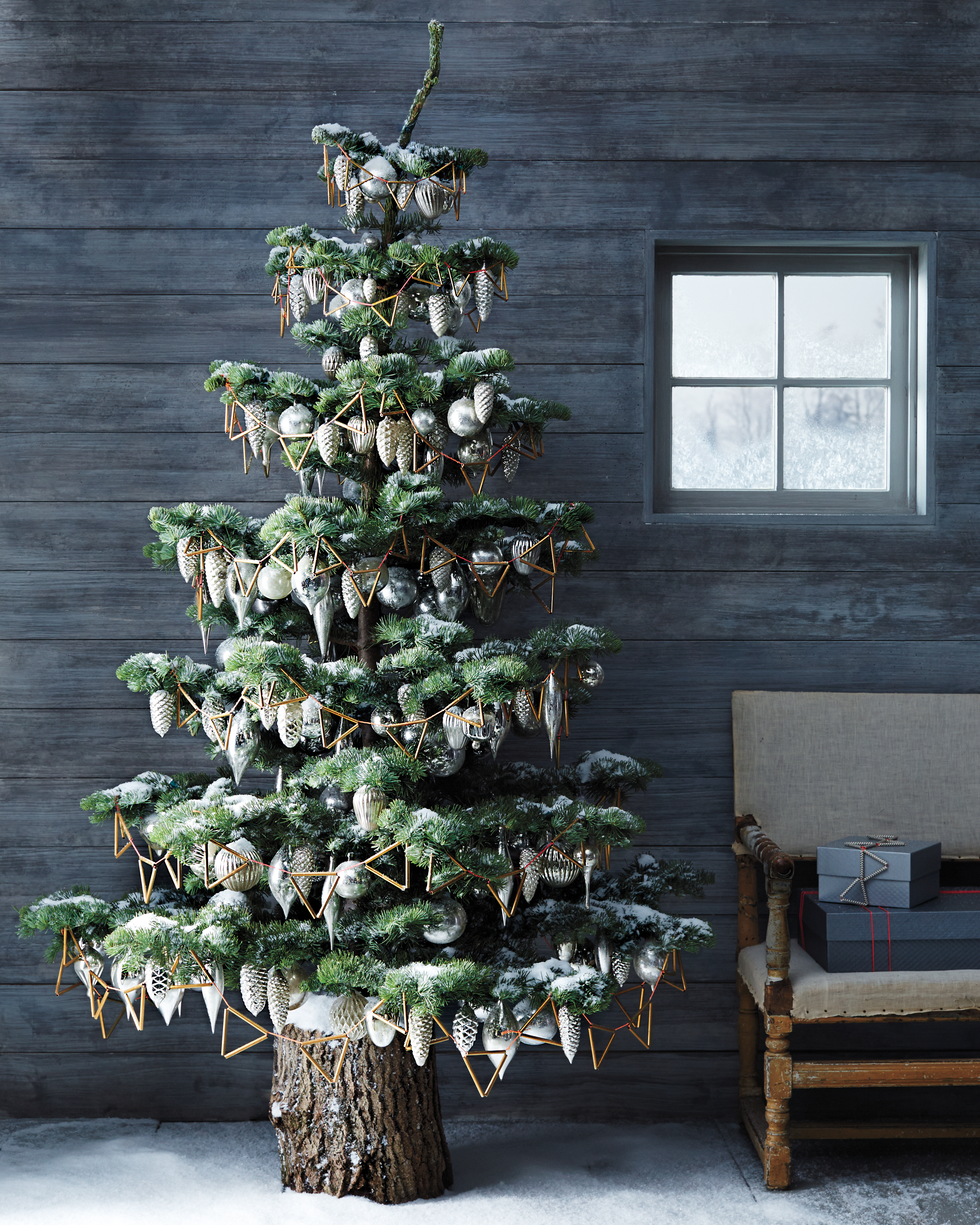 Christmas tree decorated with geometric brass hardware