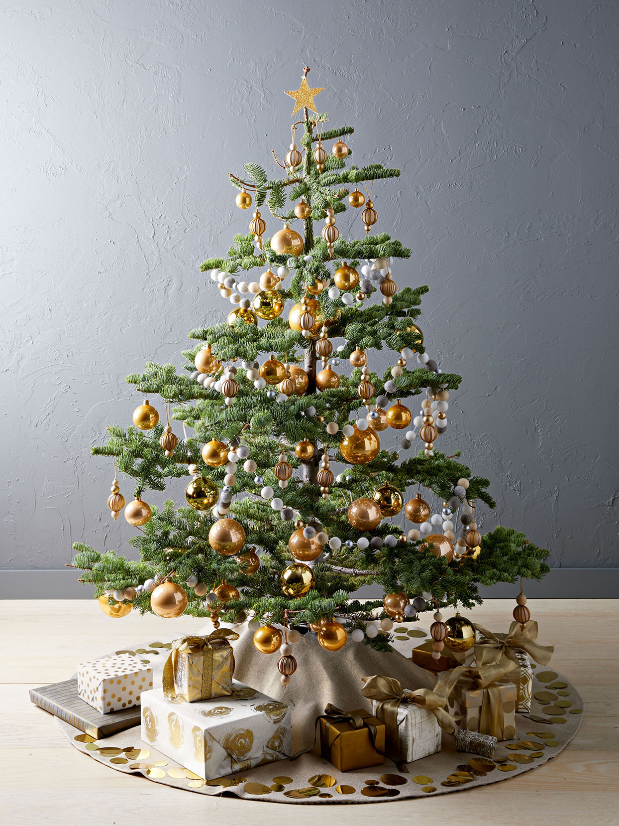 christmas tree decorated with golden ornaments