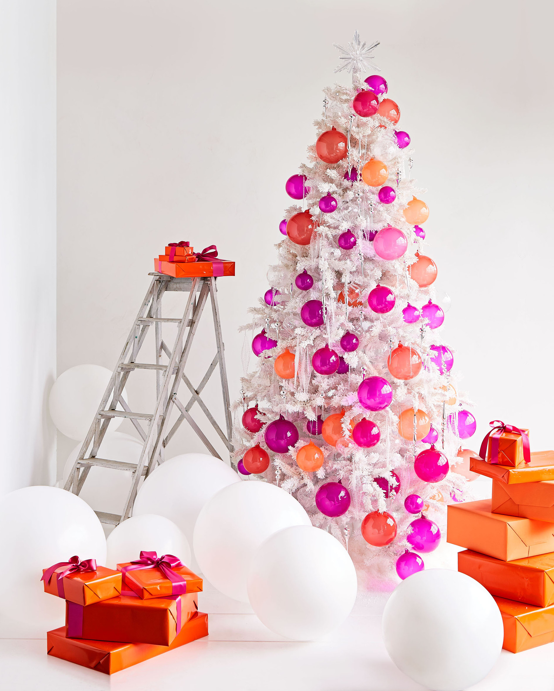 white Christmas tree of pink and orange ornaments