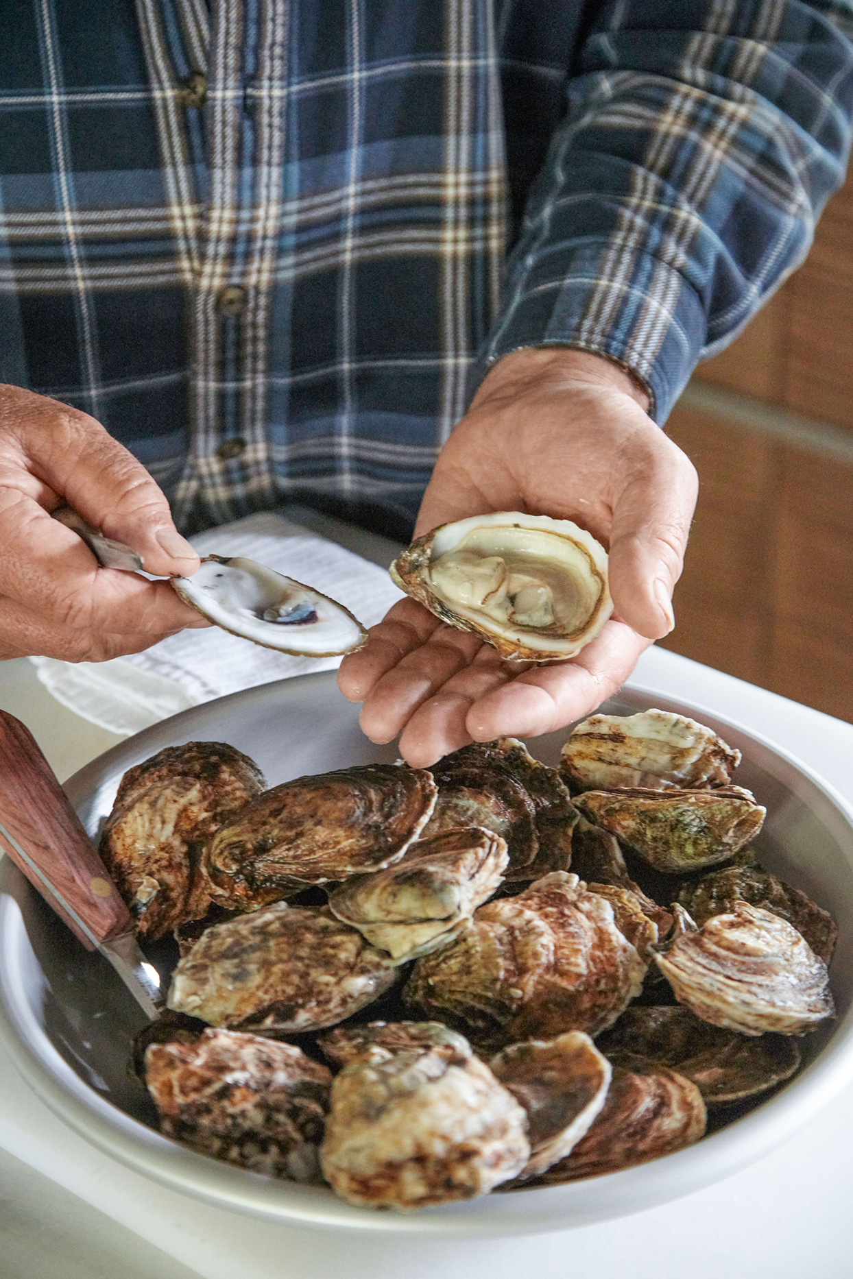 second step of shucking an oyster