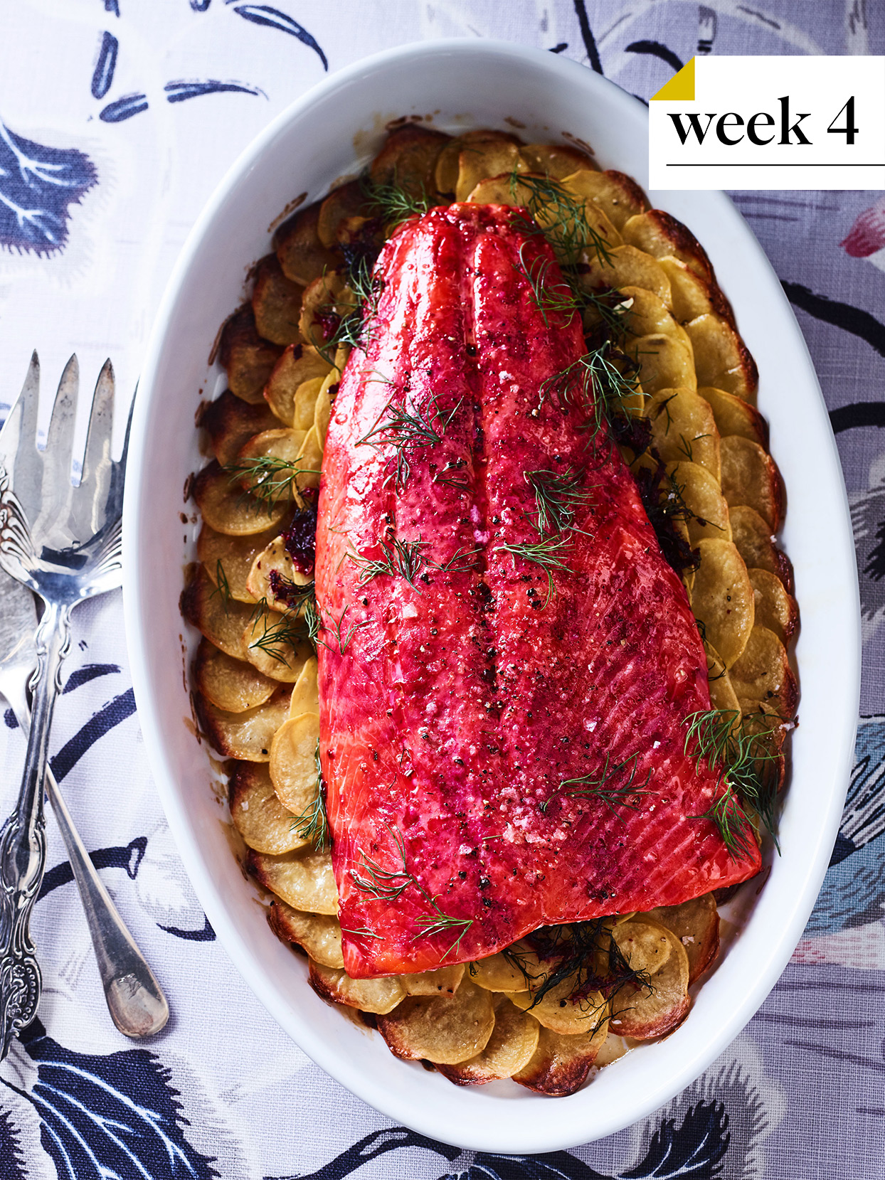 beet and dill roasted wild salmon in a white casserole dish