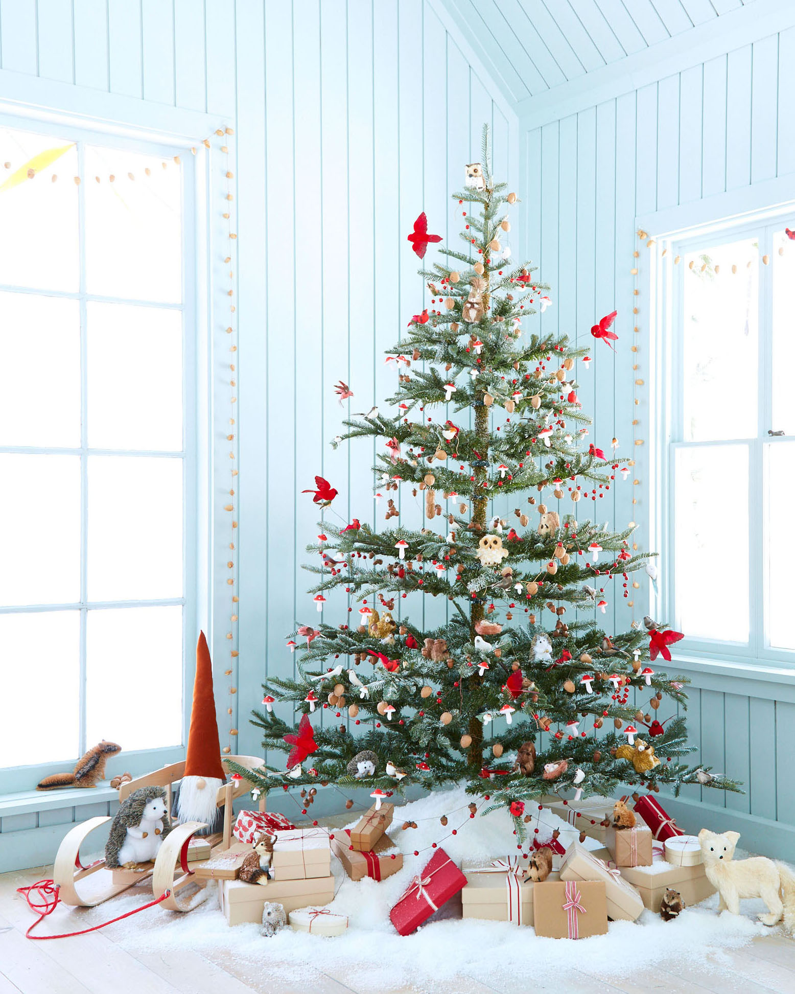 Christmas tree decorated with woodland creatures red birds