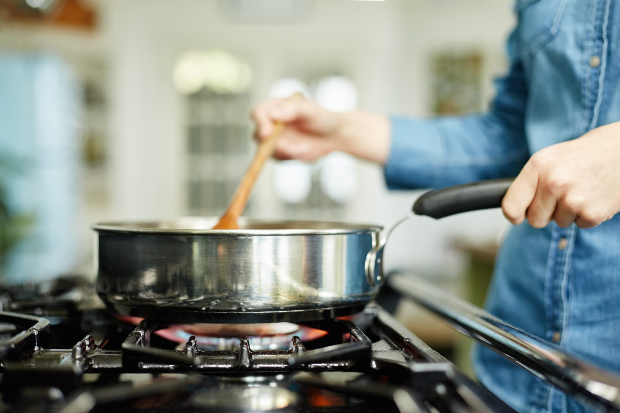 woman cooking on gas stove