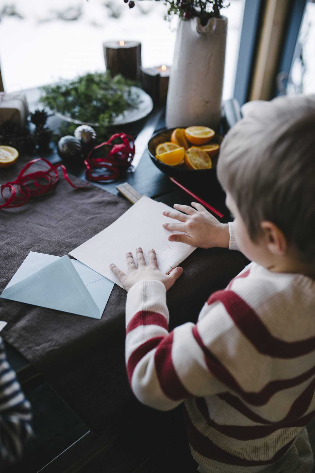 boy writing a letter to Santa