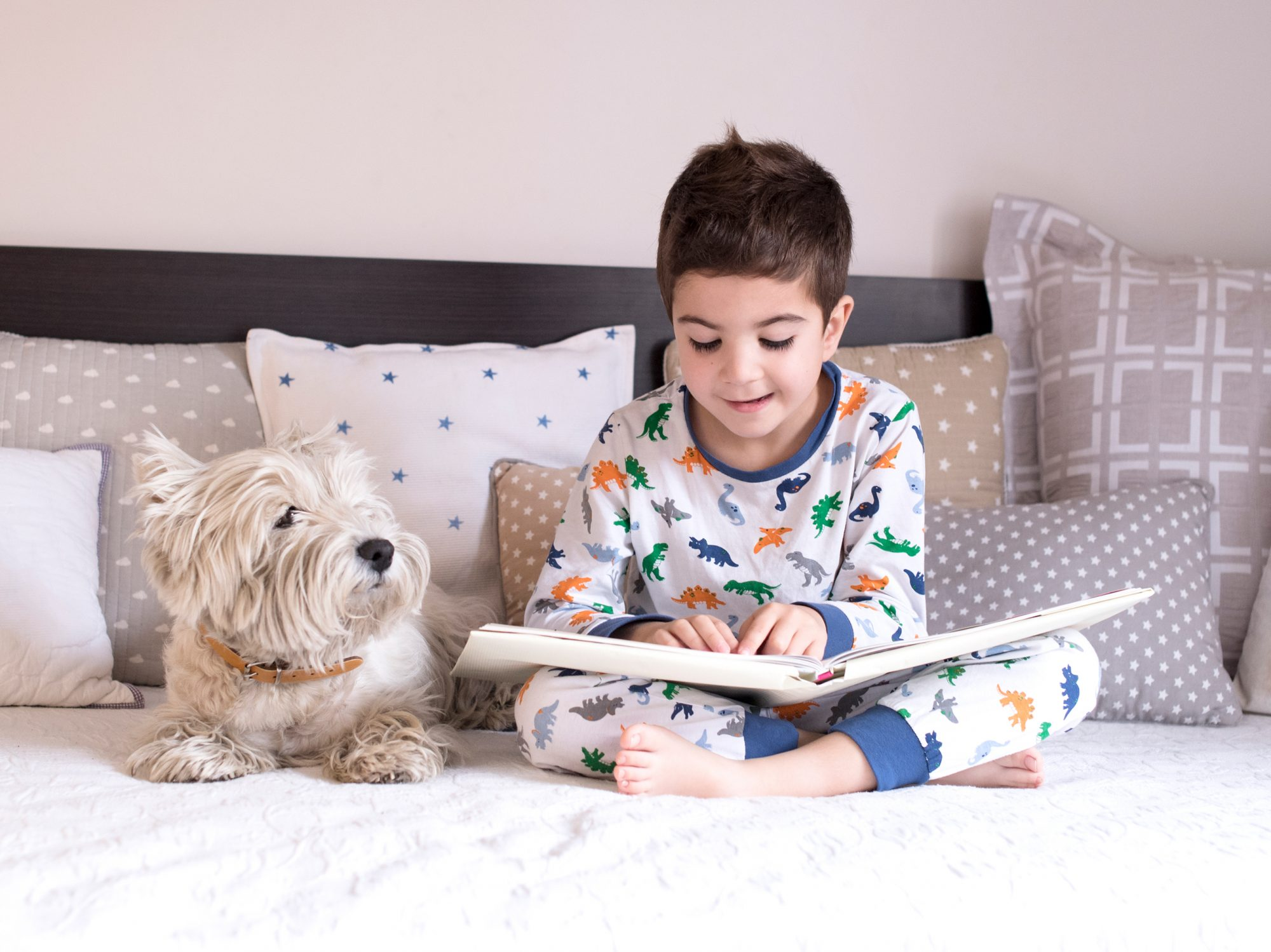 Kids in Bedroom Reading with Dogs