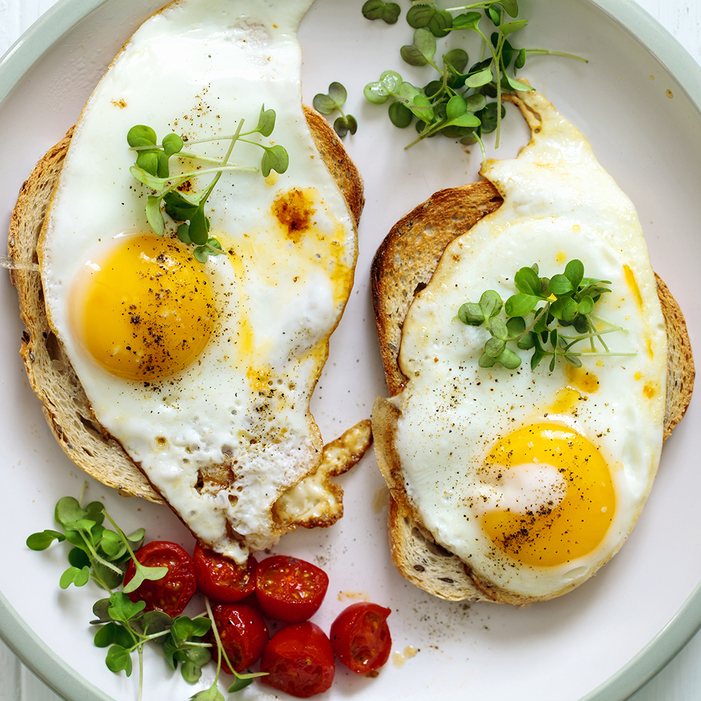 Eggs sunny-side-up on toast for breakfast