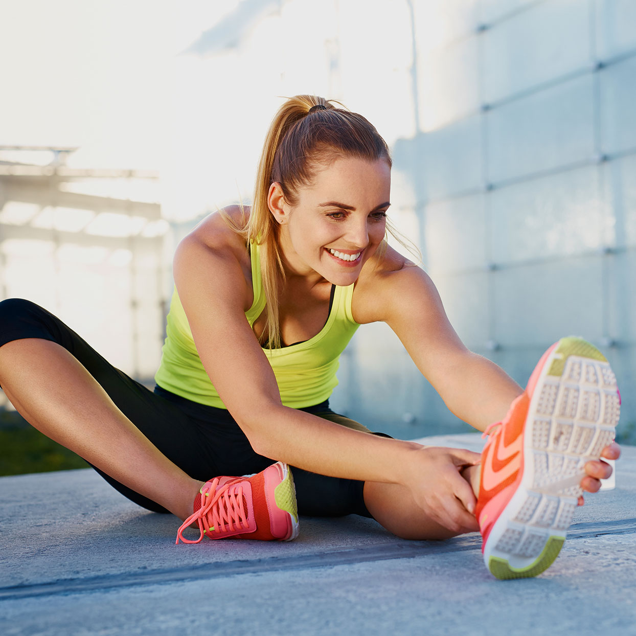 A woman stretches and improves her flexibility after a workout