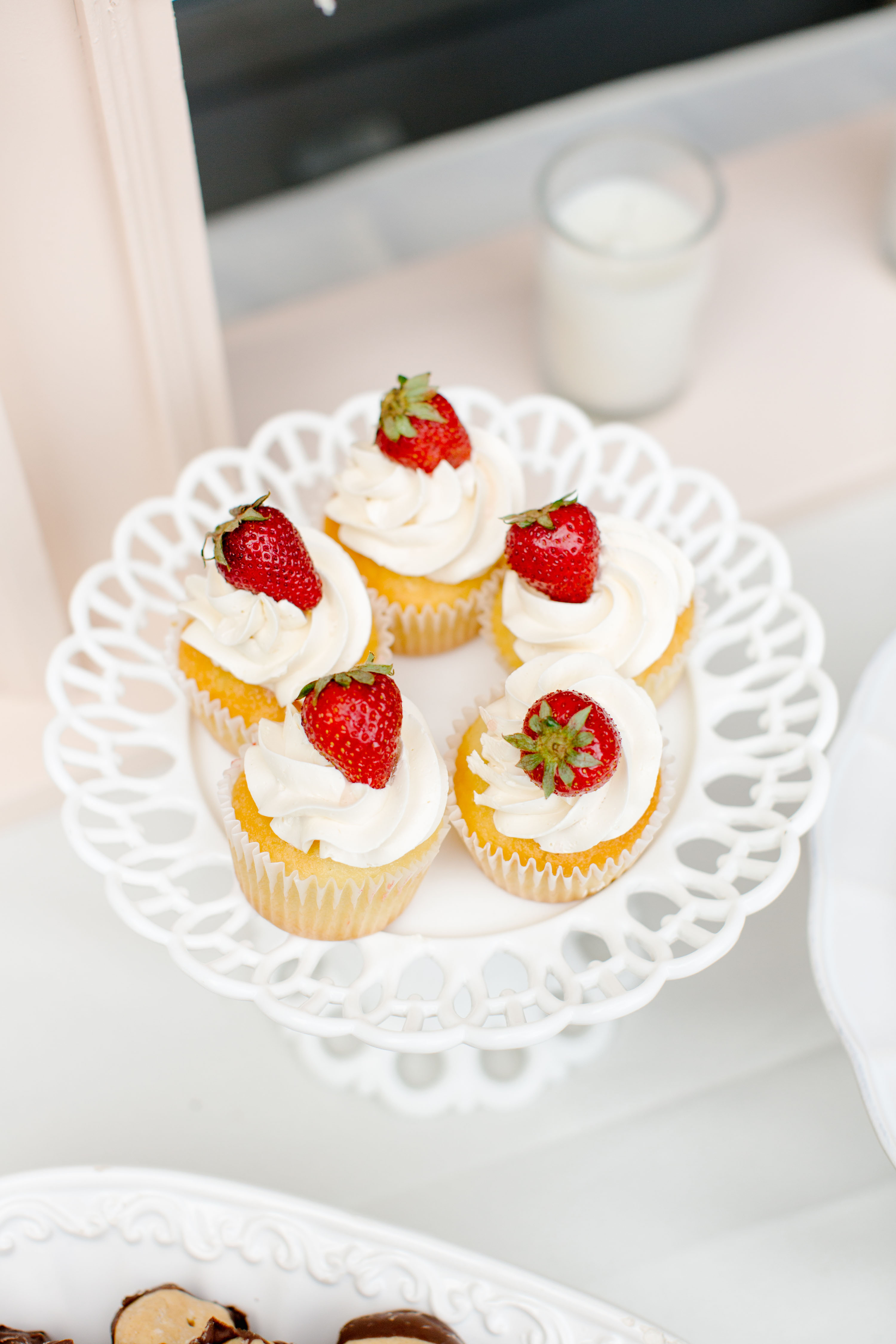 vanilla frosted cupcakes with strawberries