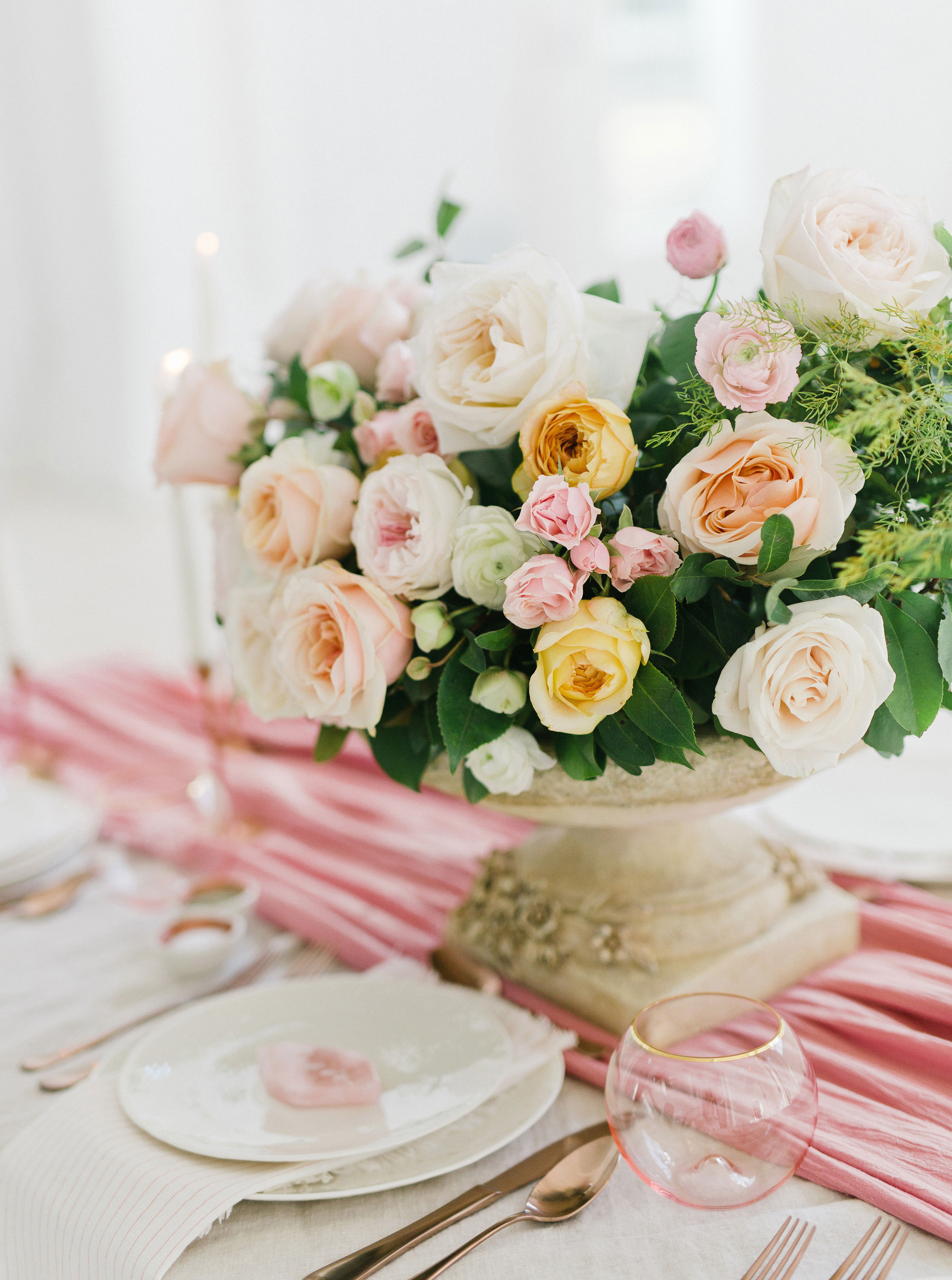 place setting white and pink floral centerpiece