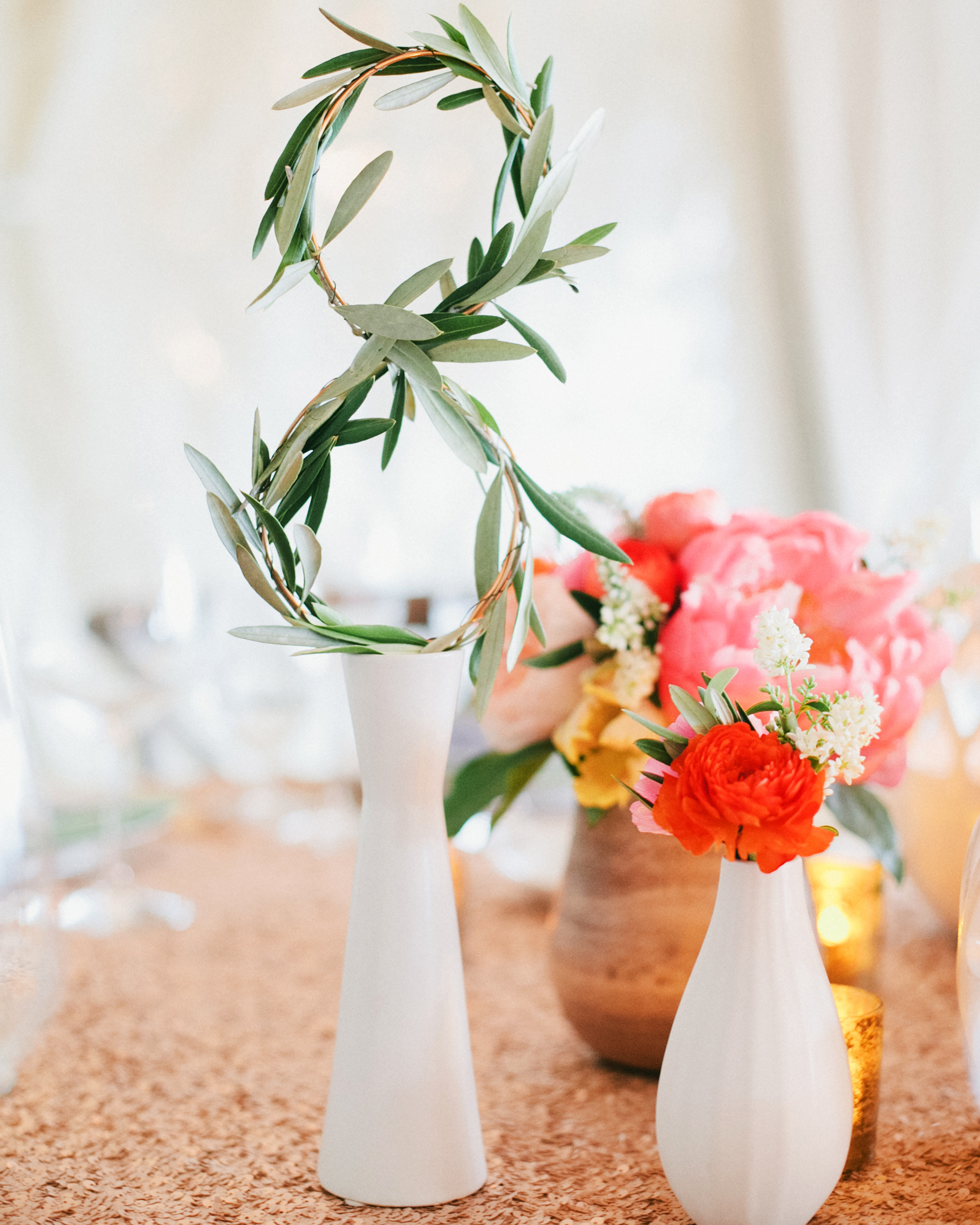 wedding table numbers greenery accents