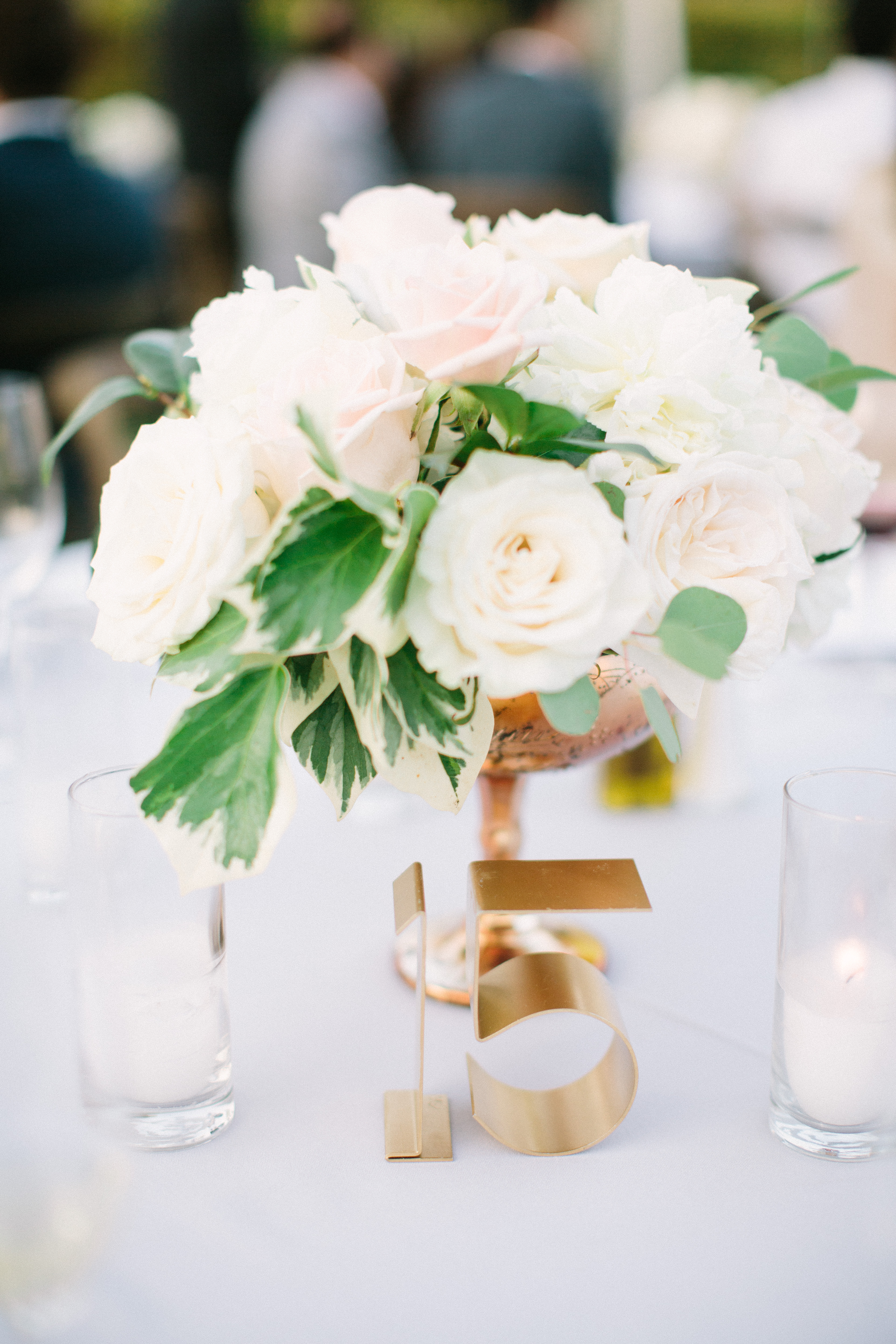 Brass metal wedding table number and white wedding centerpiece