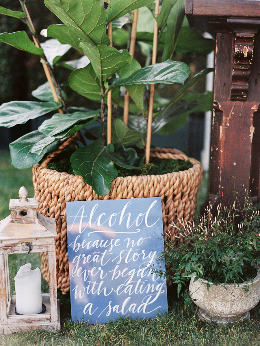 wedding bar sign alcohol blue plants candles display