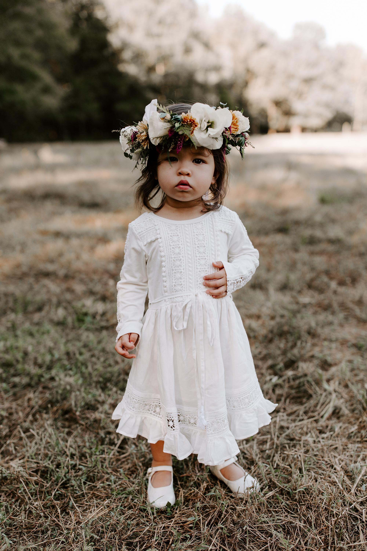 flower girl wearing eyelet lace dress