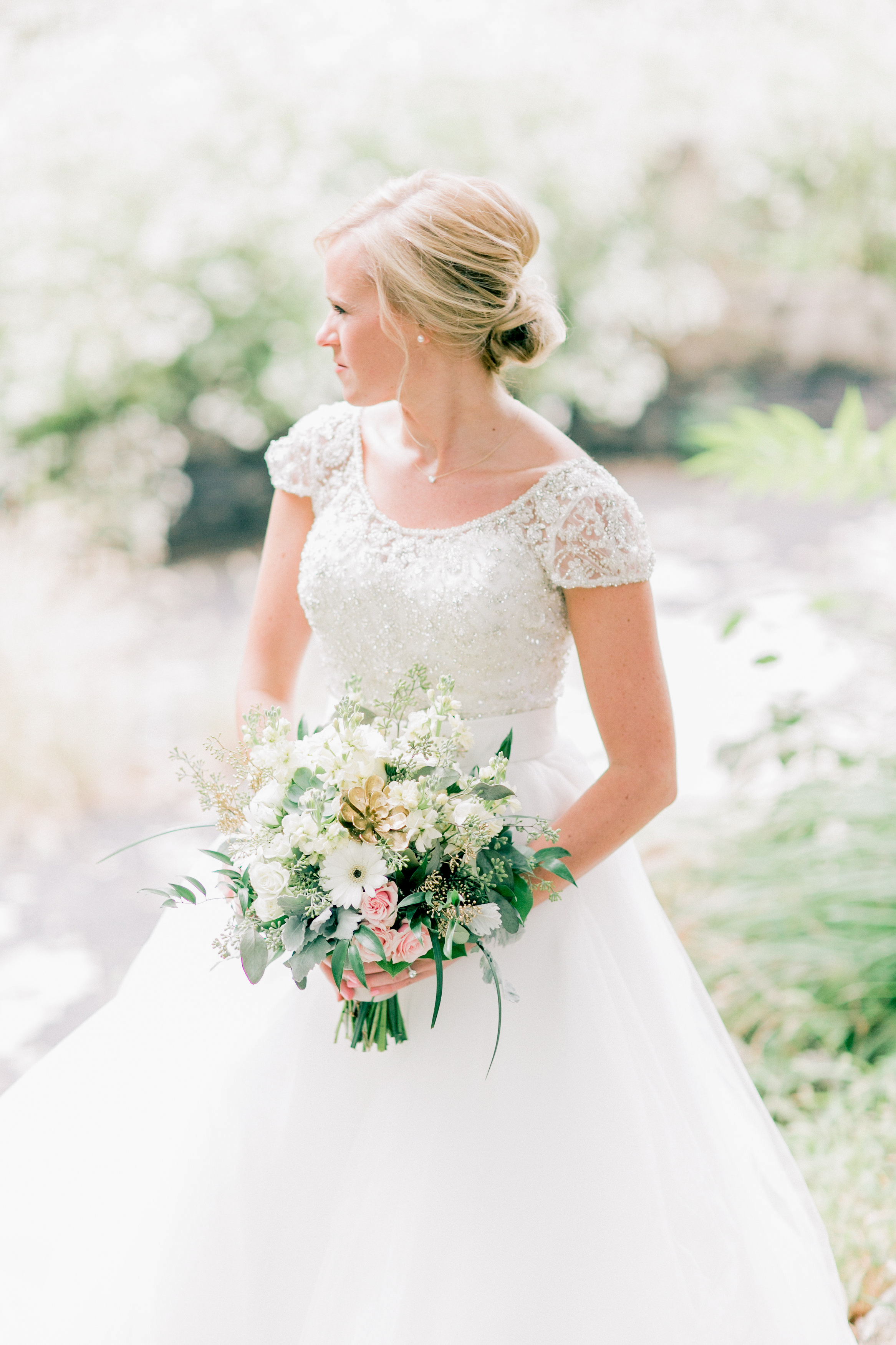 bride wearing scoop neckline with choker