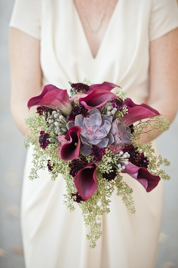 bouquet with maroon calla lilies succulents and seeded eucalyptus