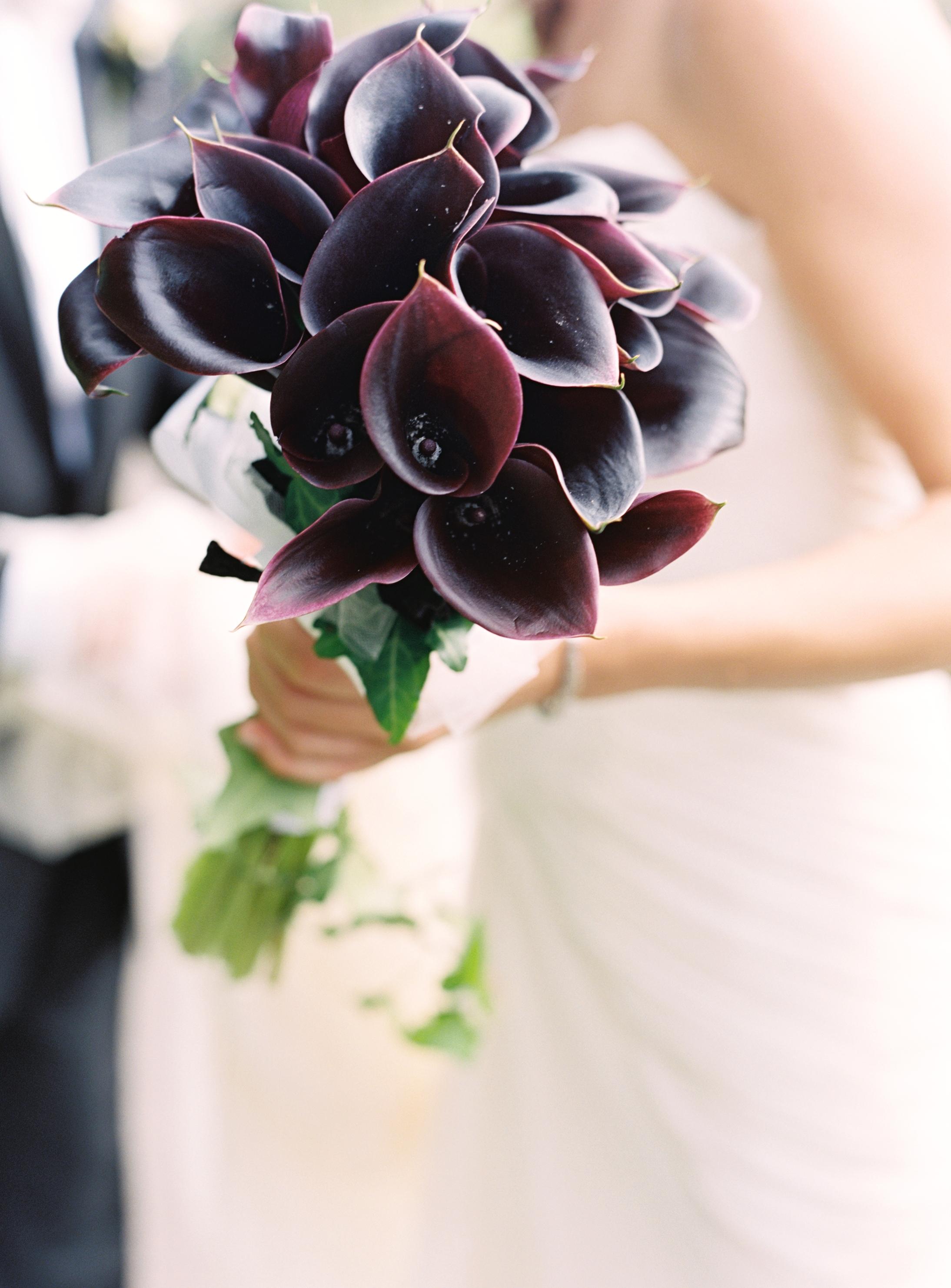 bouquet with dark purple calla lilies