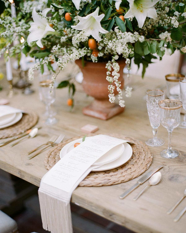 kumquats embellishing floral arrangement centerpieces