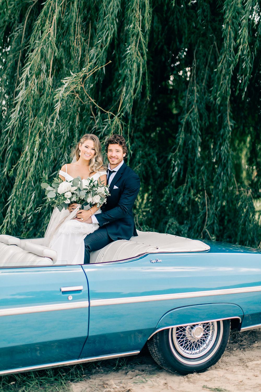 maggie zach wedding couple in vintage car
