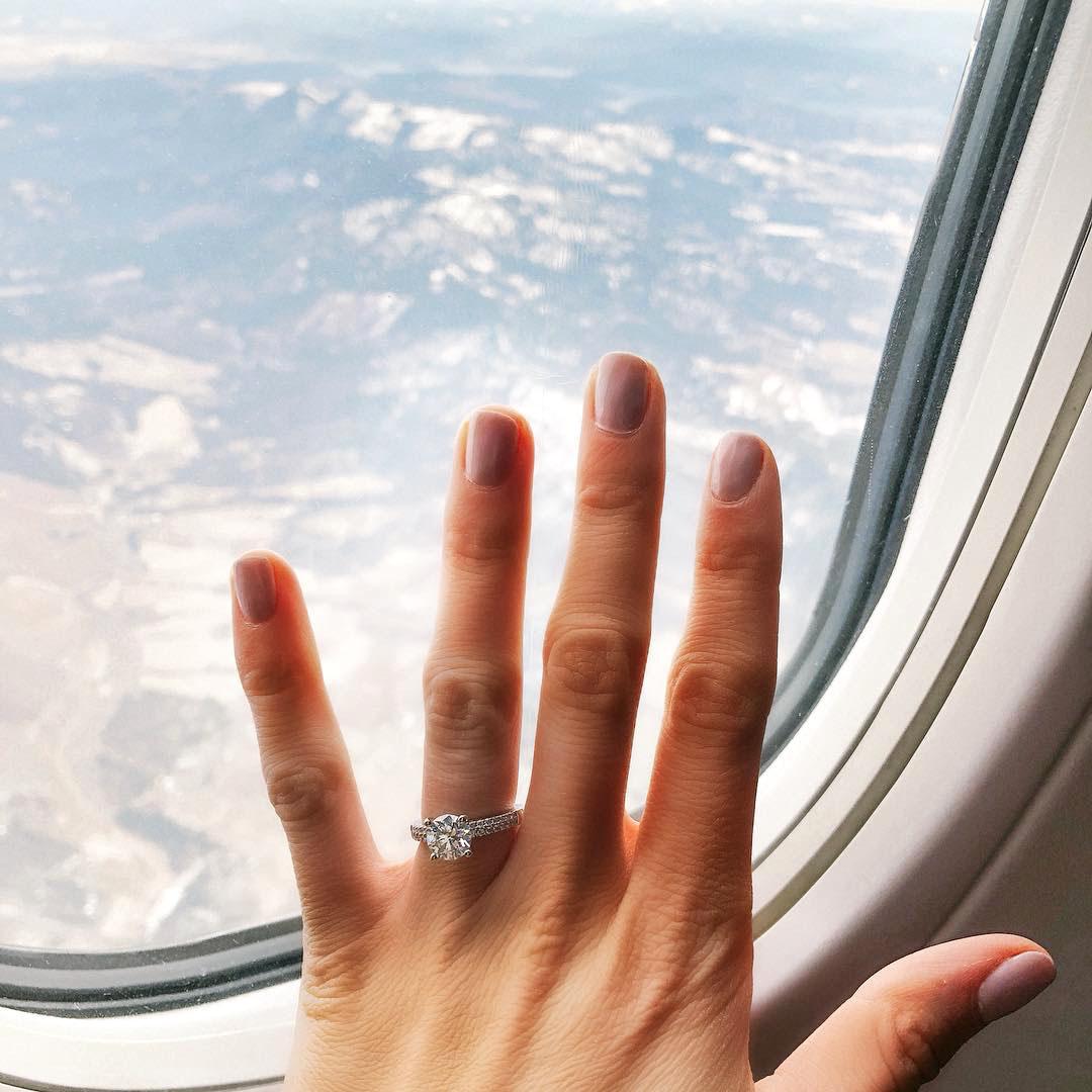 engagement ring selfie airplane window