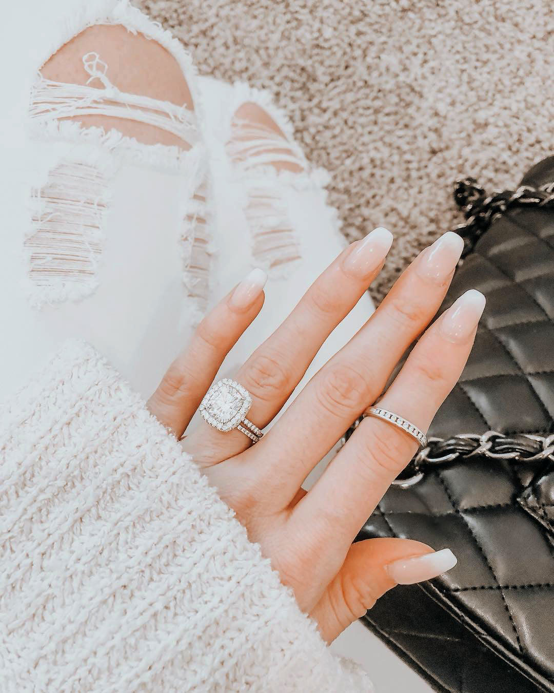 engagement ring selfie white monochromatic outfit with distressed jeans