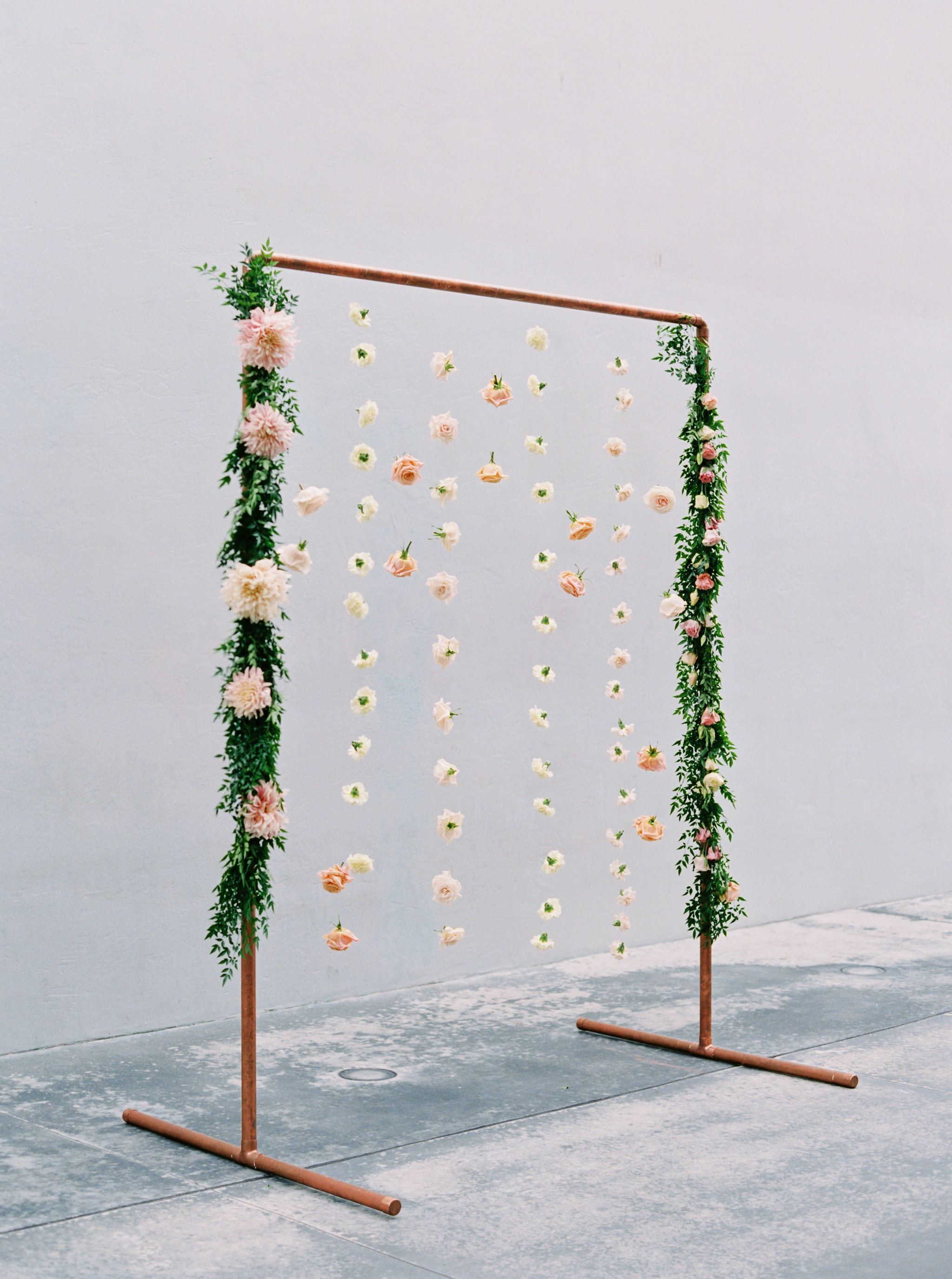 dahlias and carnations suspended from copper frame