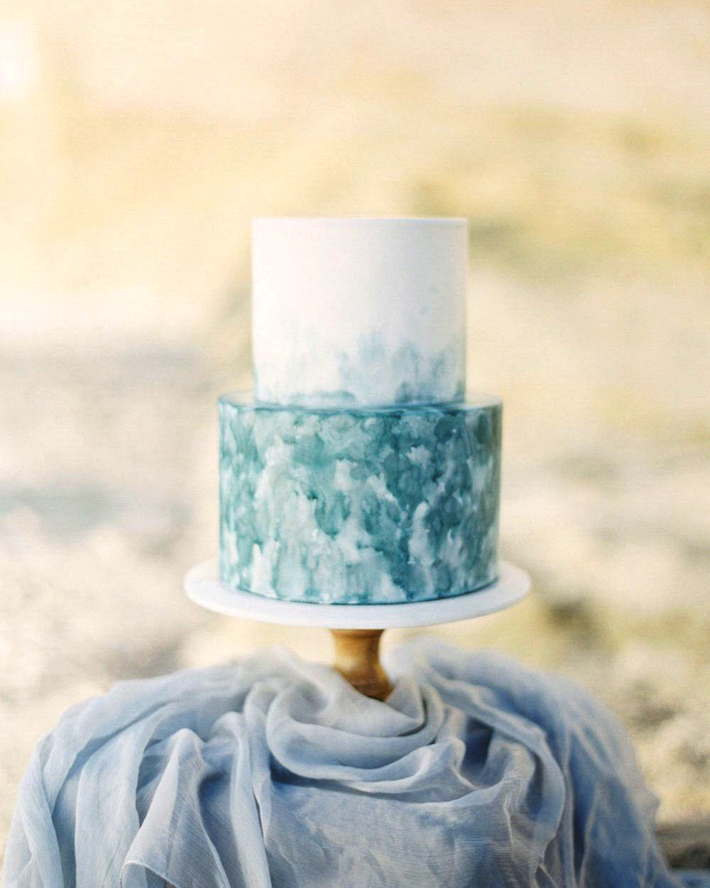 white and blue frosted wedding cake
