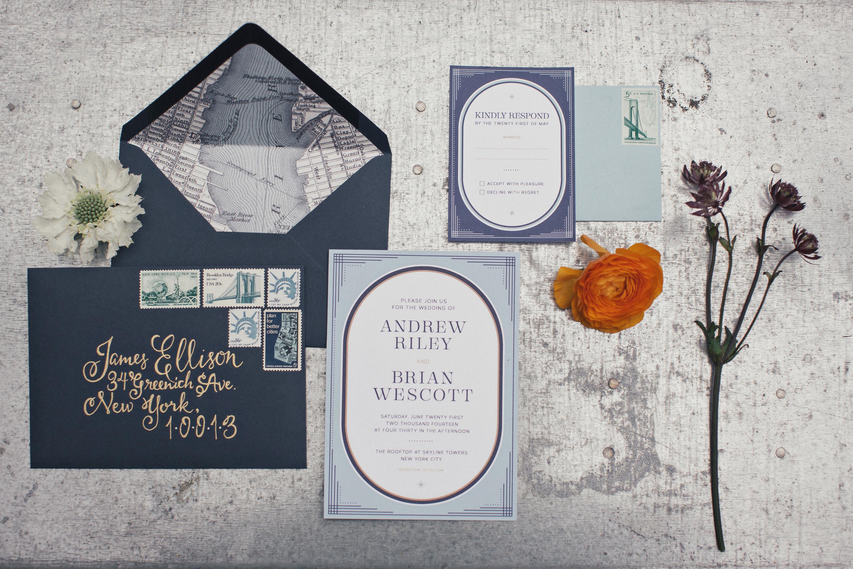 dark blue vintage invites with envelope flap map illustration