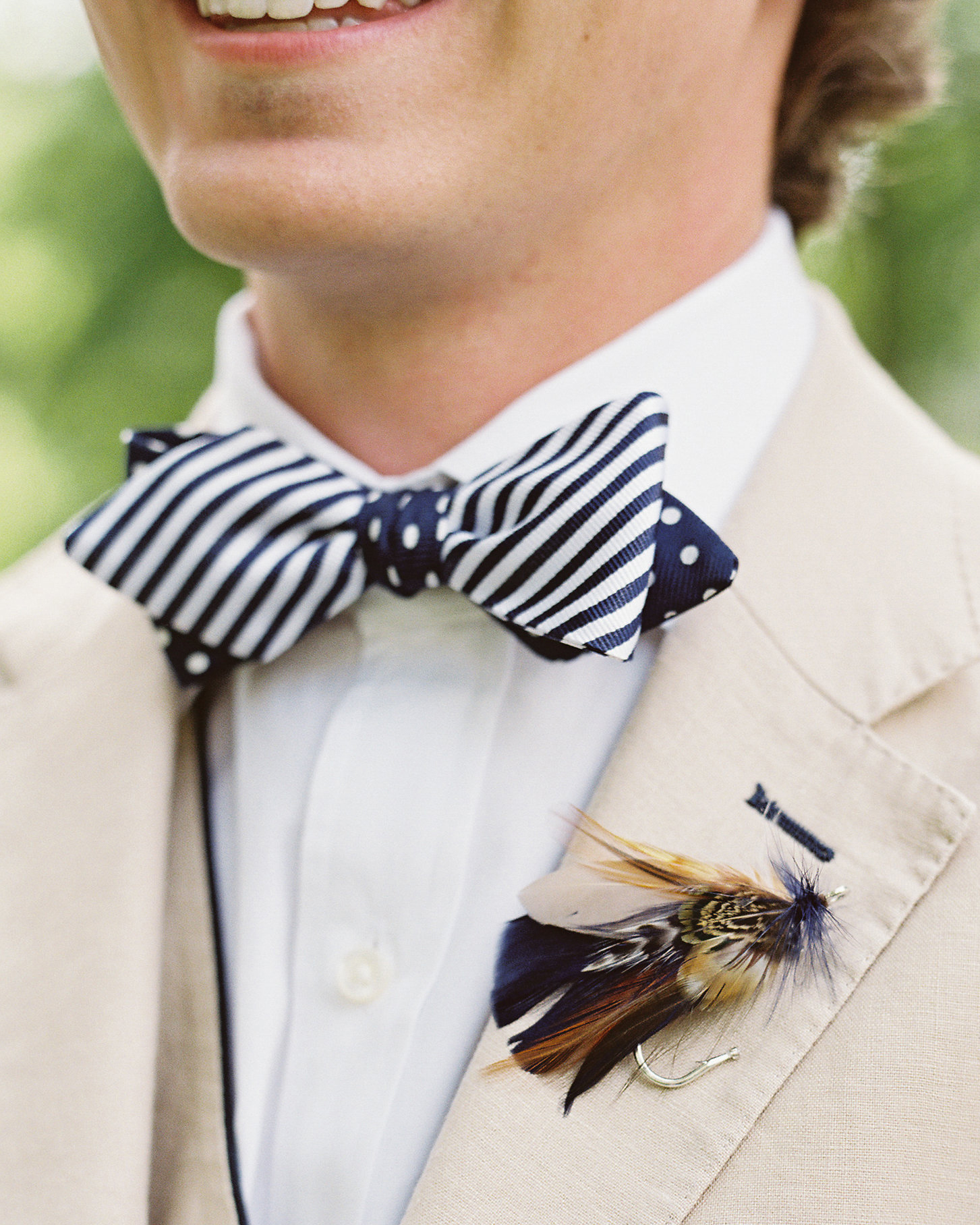 striped and polka dot bow tie with tan suit