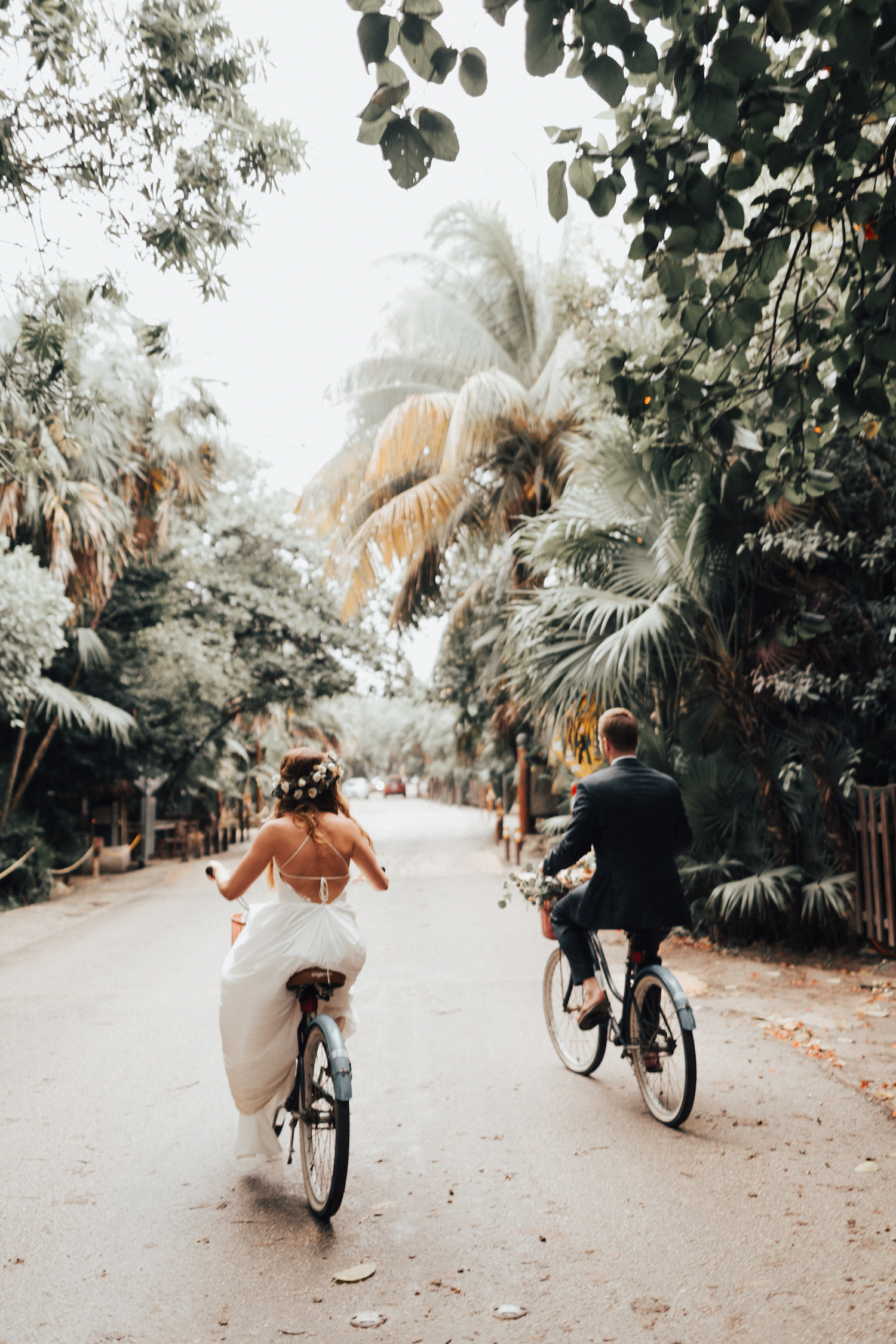 bride and groom riding bikes