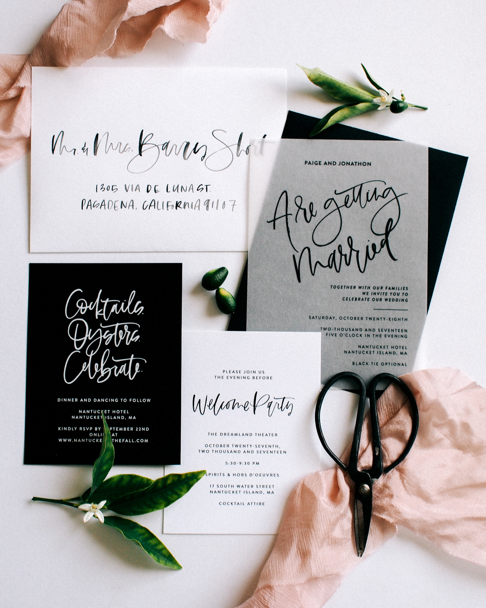 black white invitation suite with calligraphy