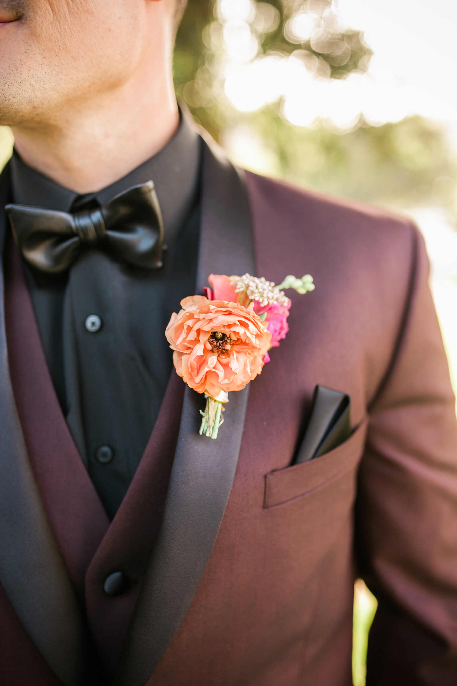 pink and orange boutonniere