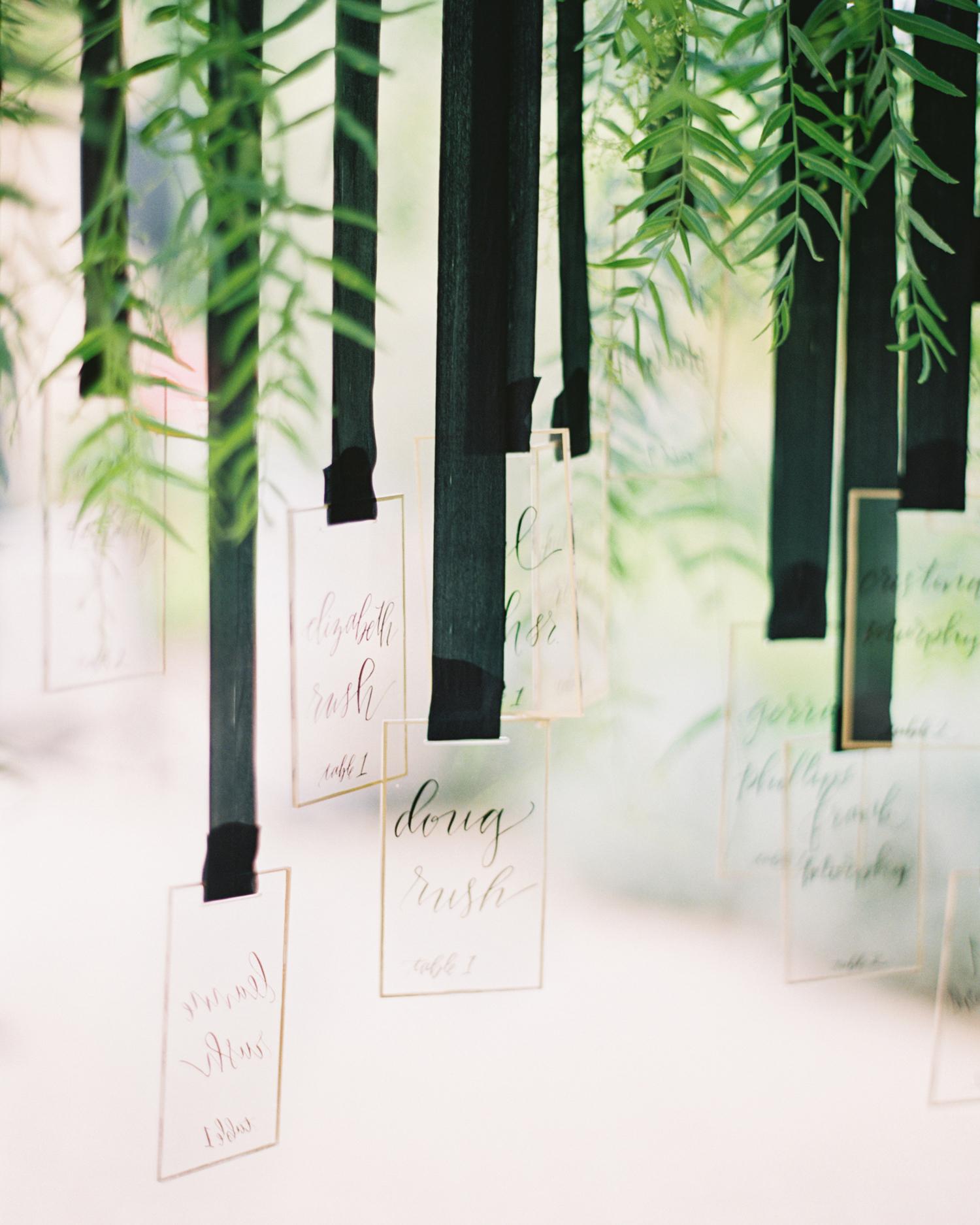ribbon wedding ideas escort cards hanging from black ribbon