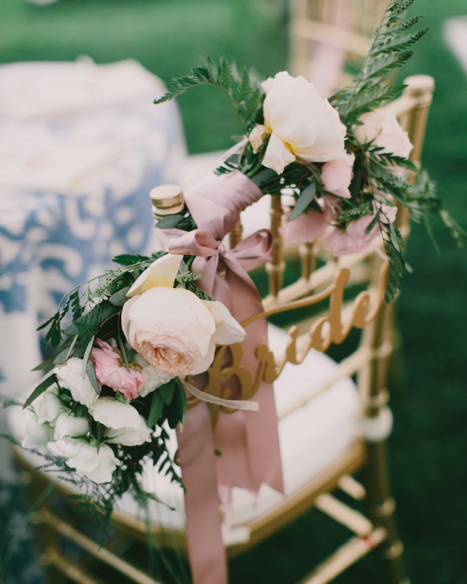 ribbon wedding ideas roses and pink ribbon adhered to brides chair