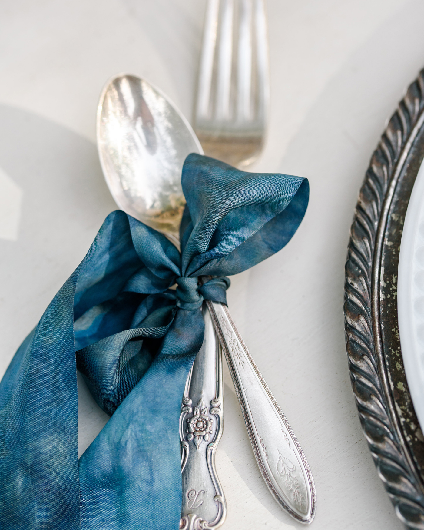 ribbon wedding ideas blue ribbon tied to silverware