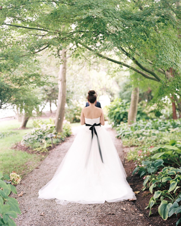 ribbon wedding ideas black ribbon tied to brides dress