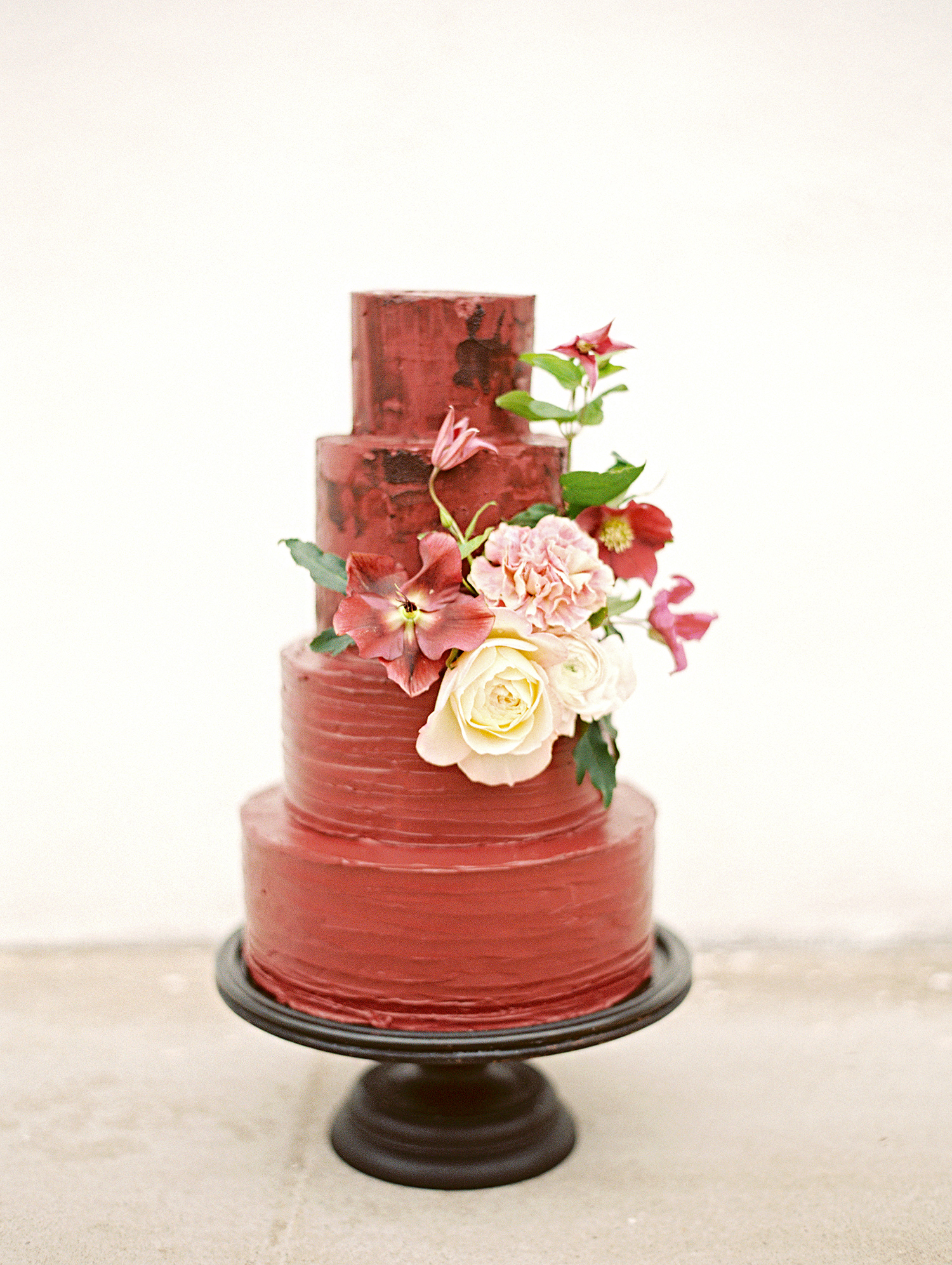 red velvet tiered cake with blooms