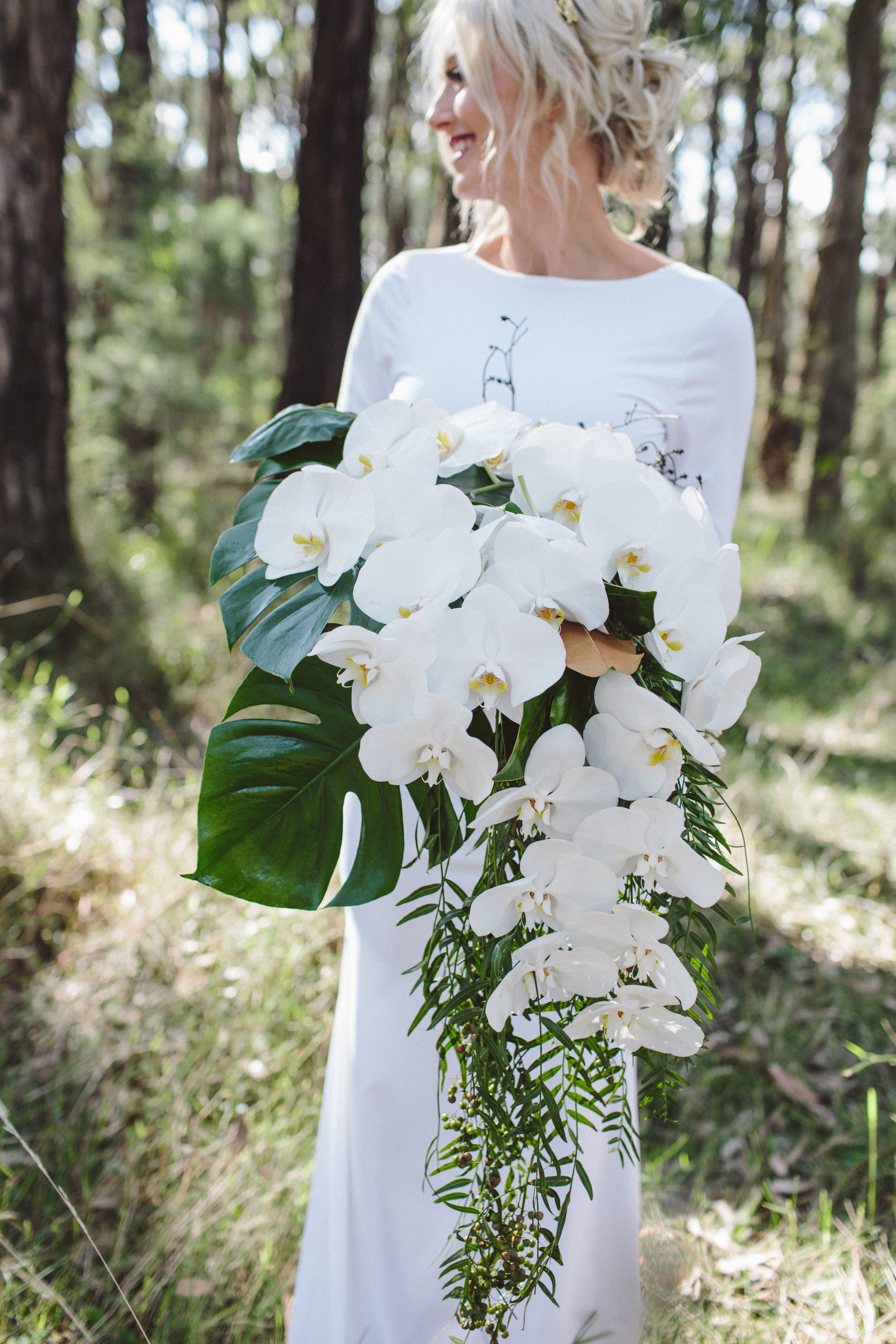 White orchid and monstera deliciosa wedding bouquet
