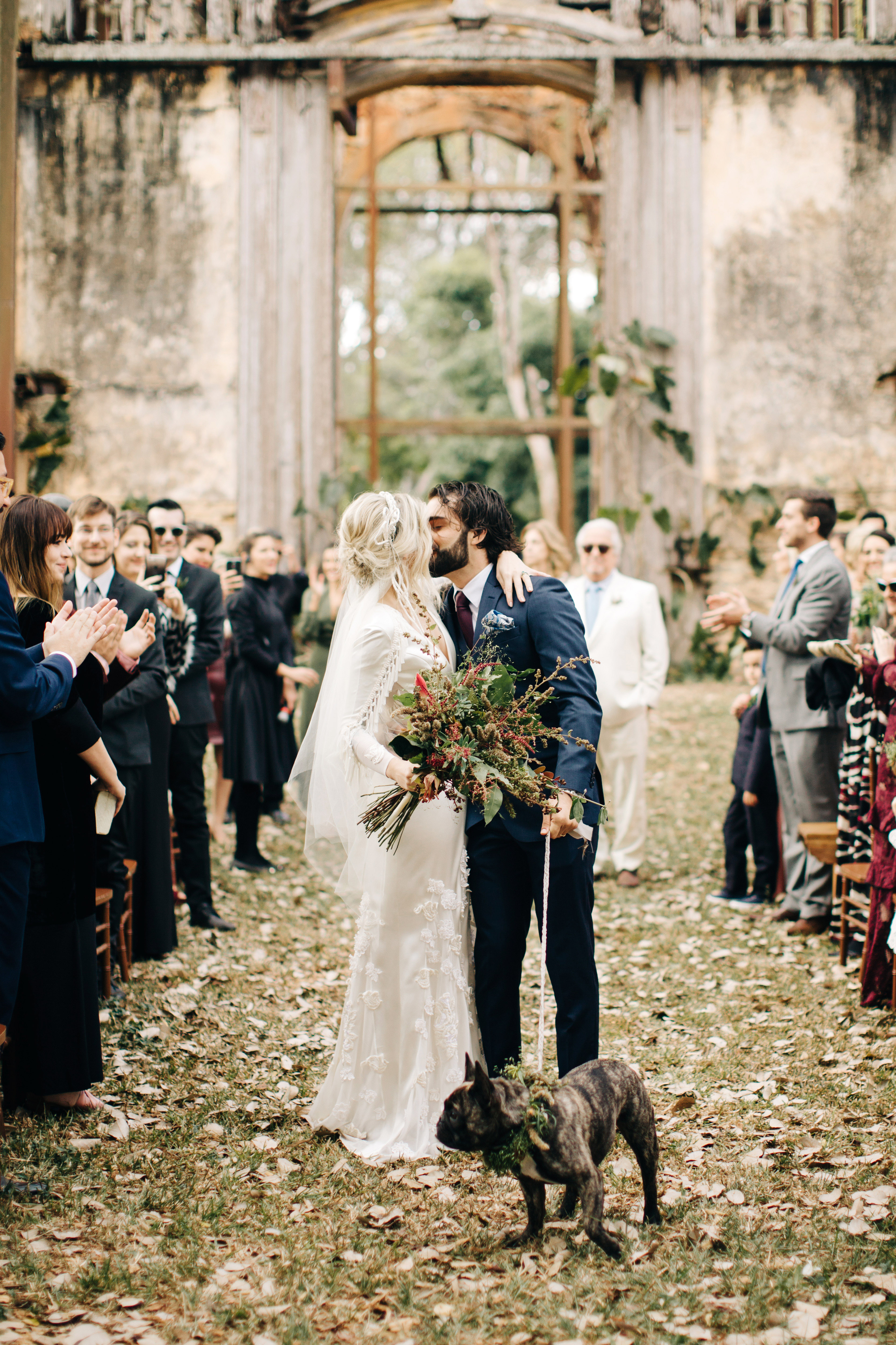 dog wedding bride groom couple kiss aisle
