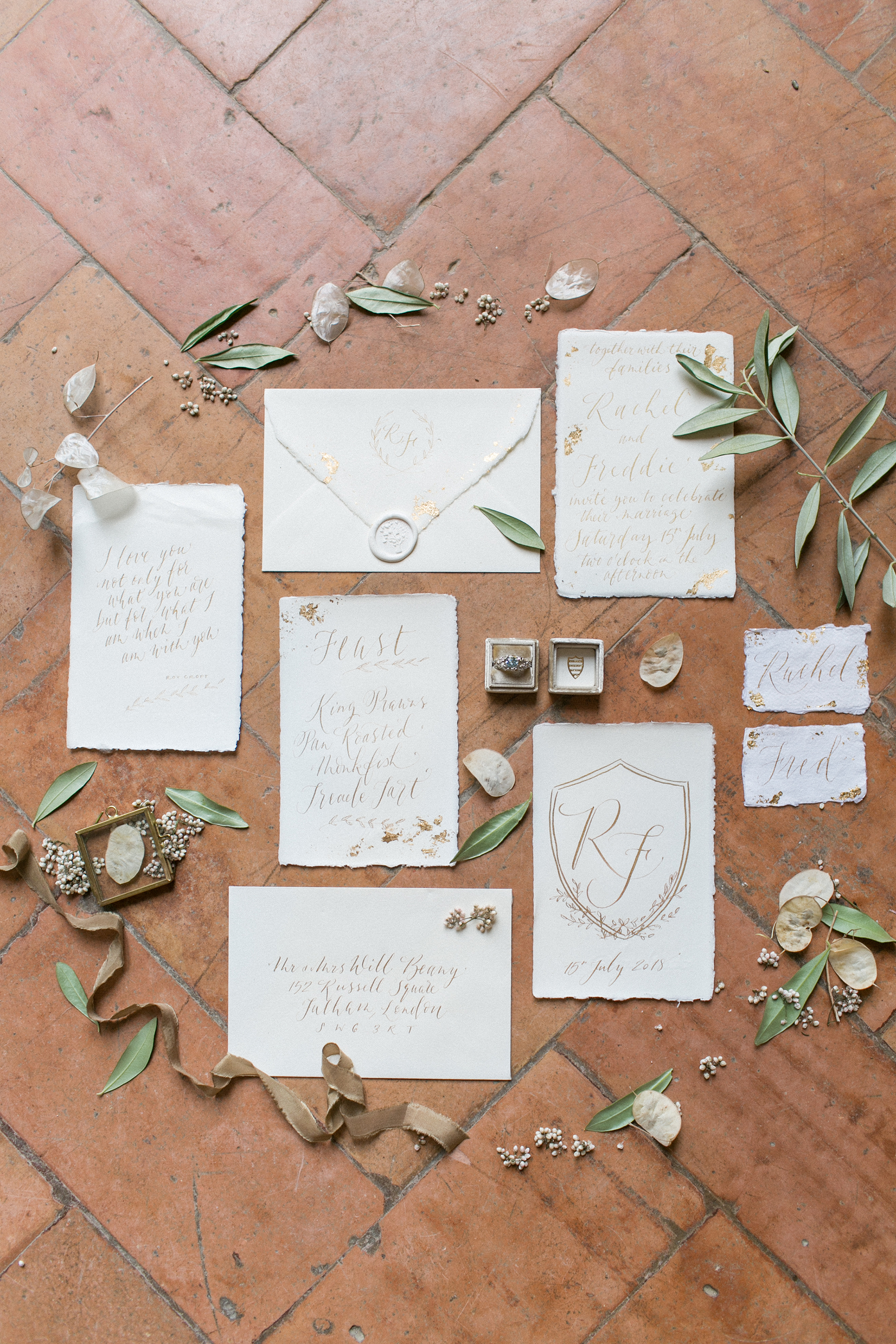 all white invites with gold monogram