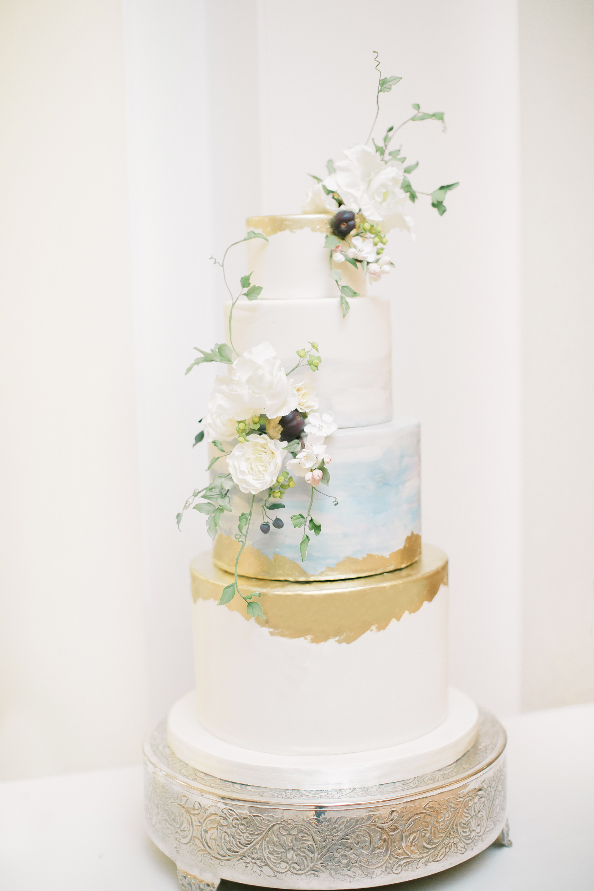 gold and blue watercolor cake