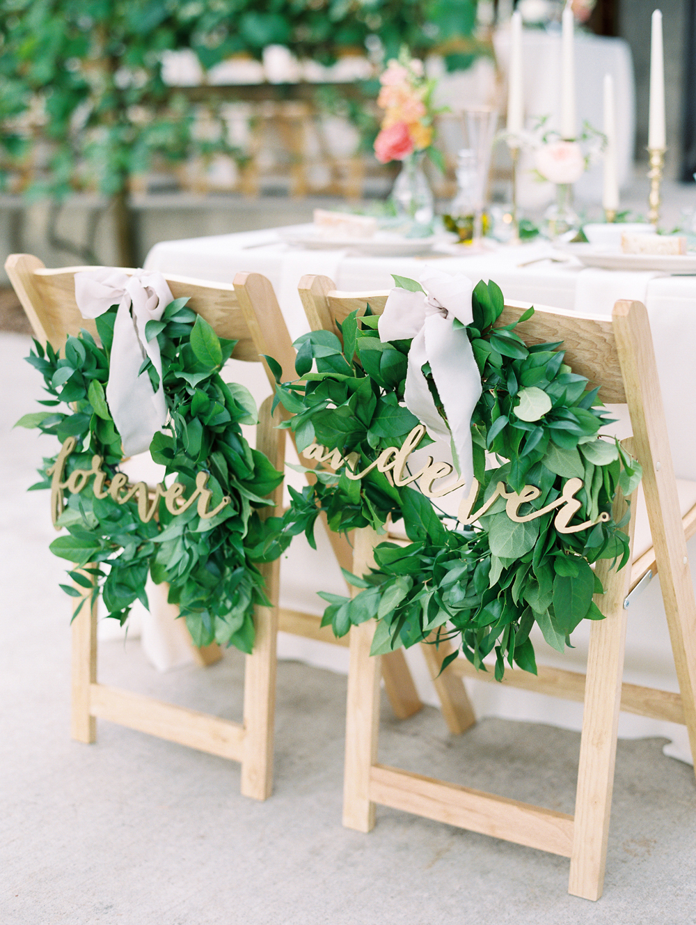 wedding wreaths decorating bride and grooms chairs