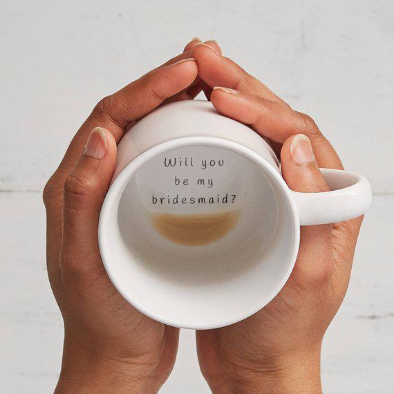 be my bridesmaid hands holding coffee mug